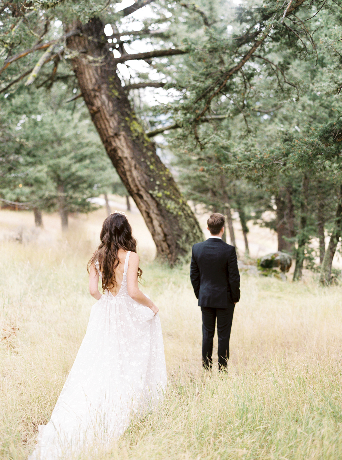 bride and groom sharing first look in forest
