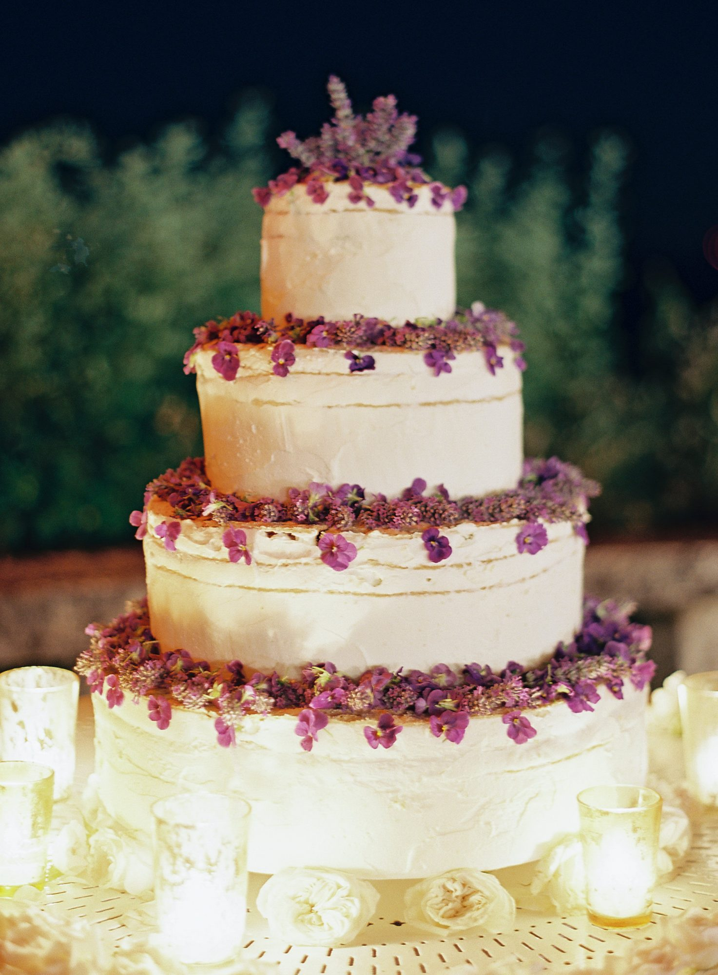 four tiered cake with blackberries and lavender mascarpone