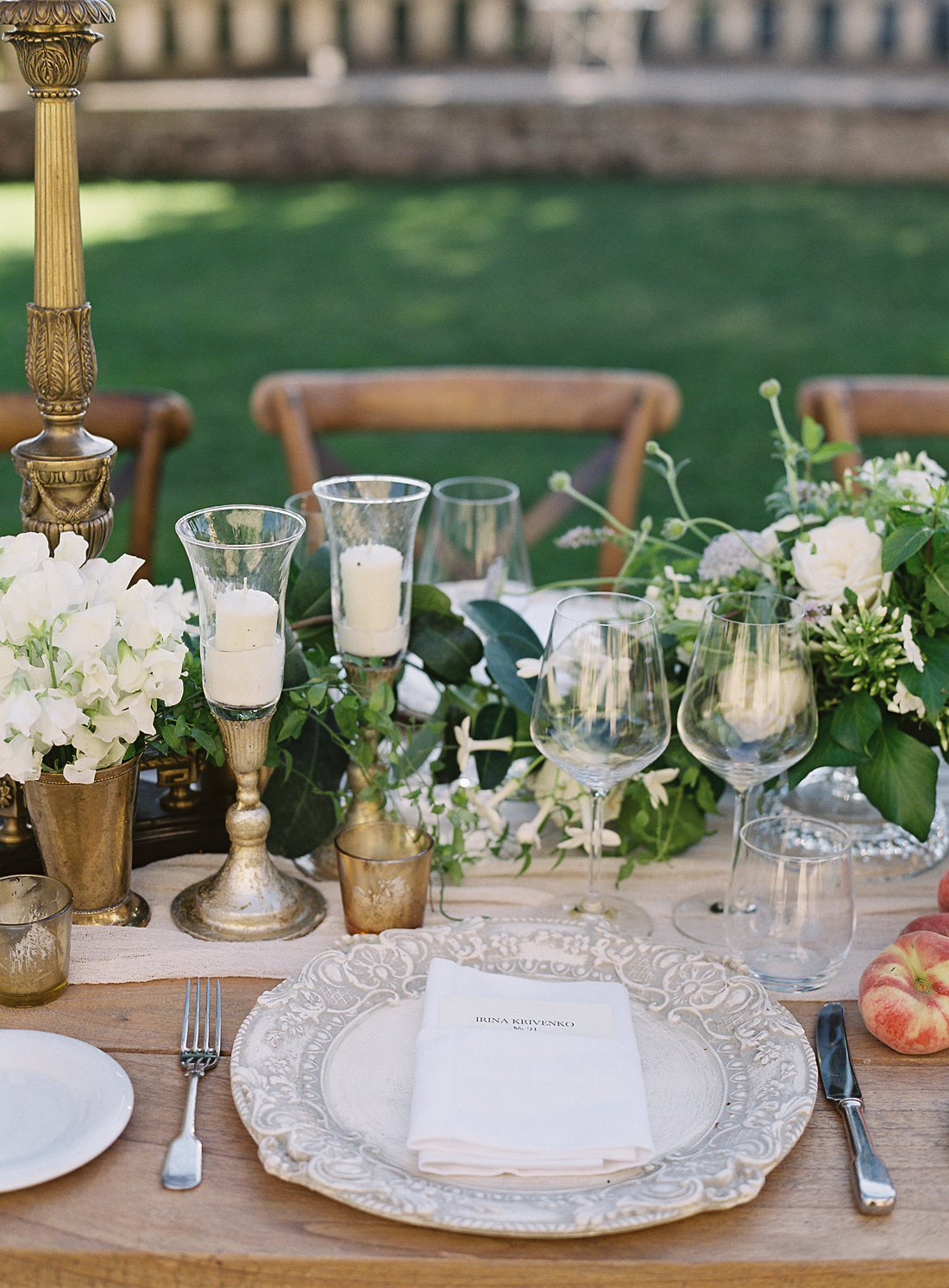 white floral centerpieces, vintage gold decor, and antique white placesettings