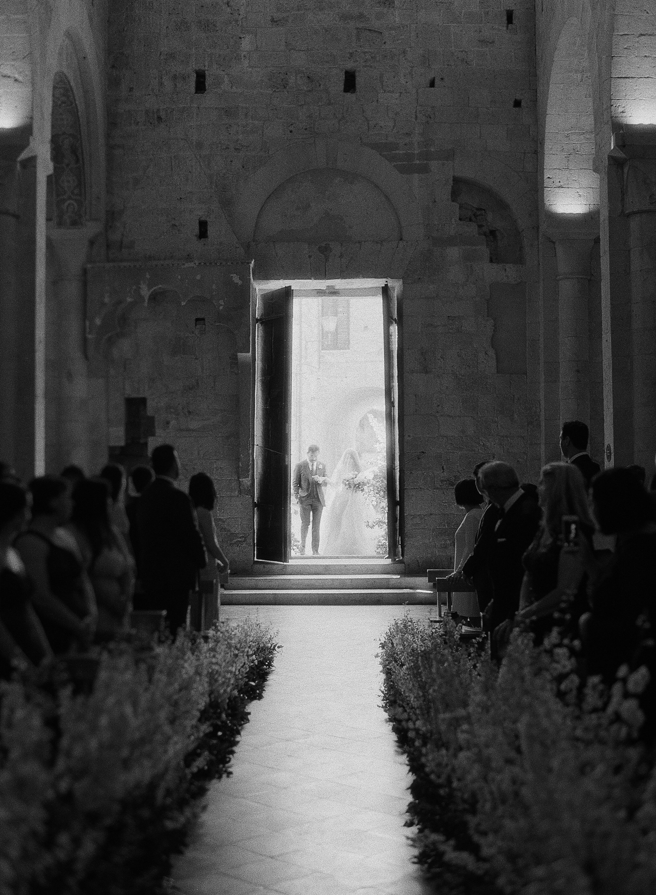 floral arch wedding processional in church