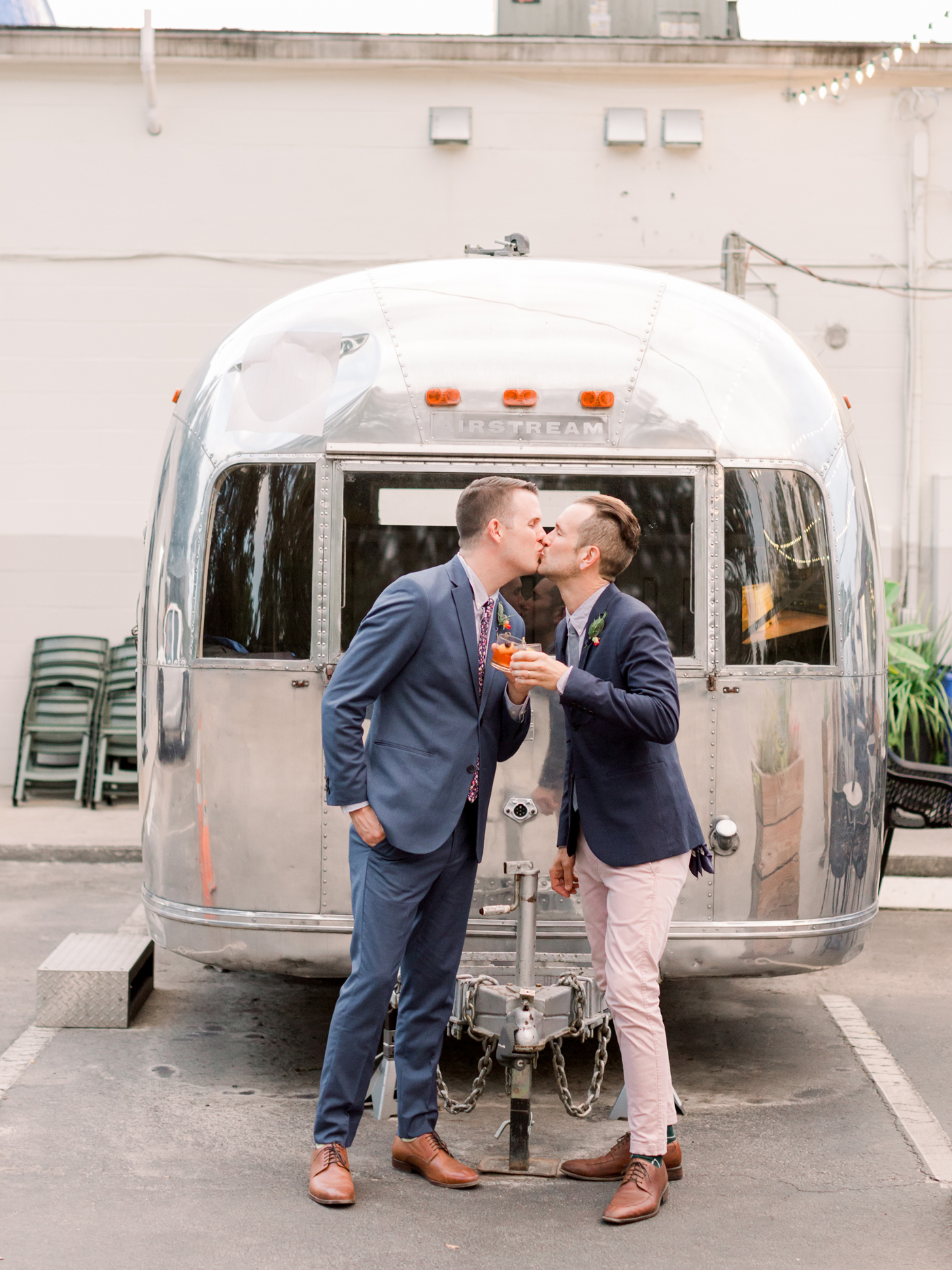 couple grooms kiss before reception