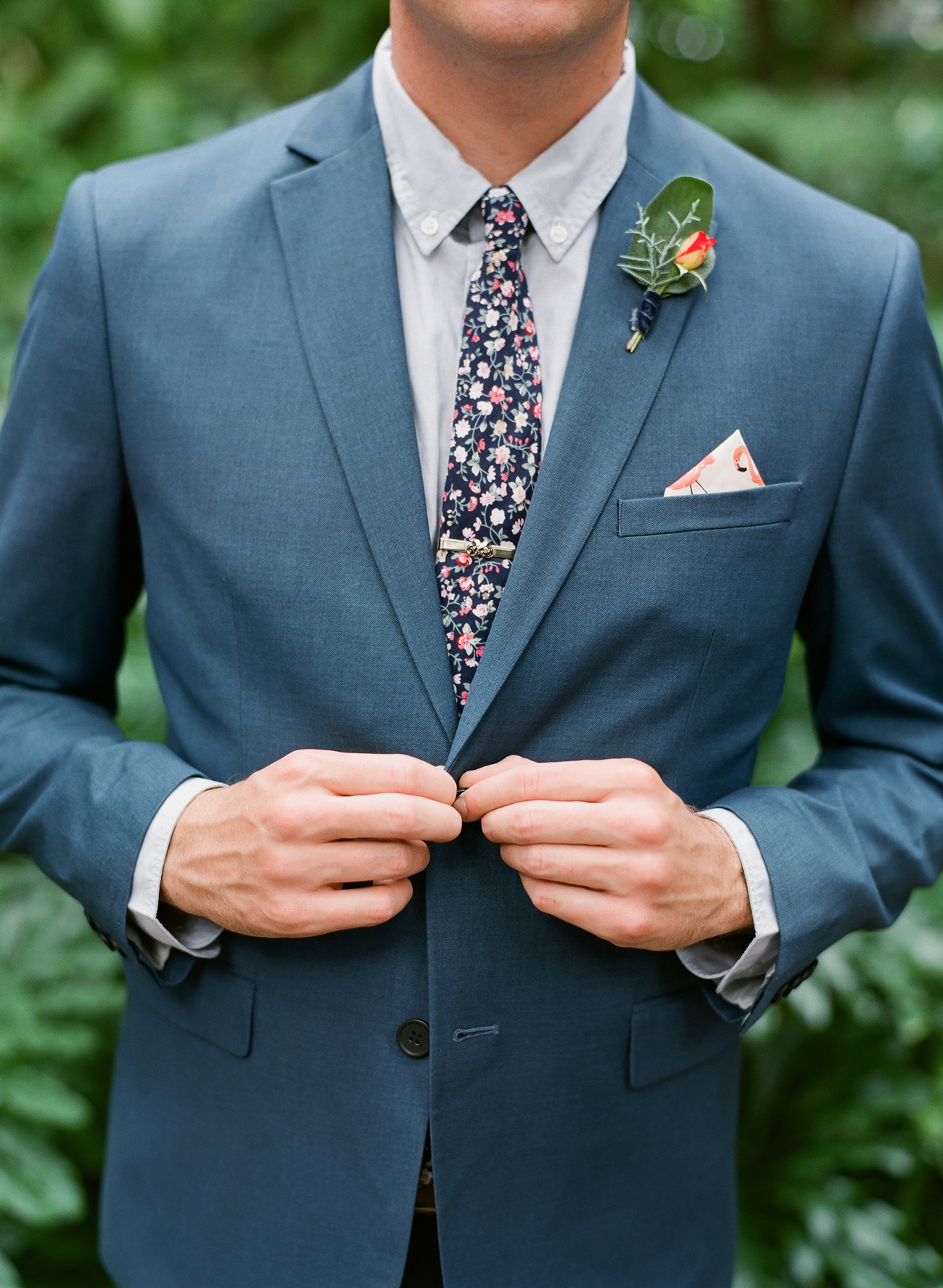 blue suit with floral tie and pocket square