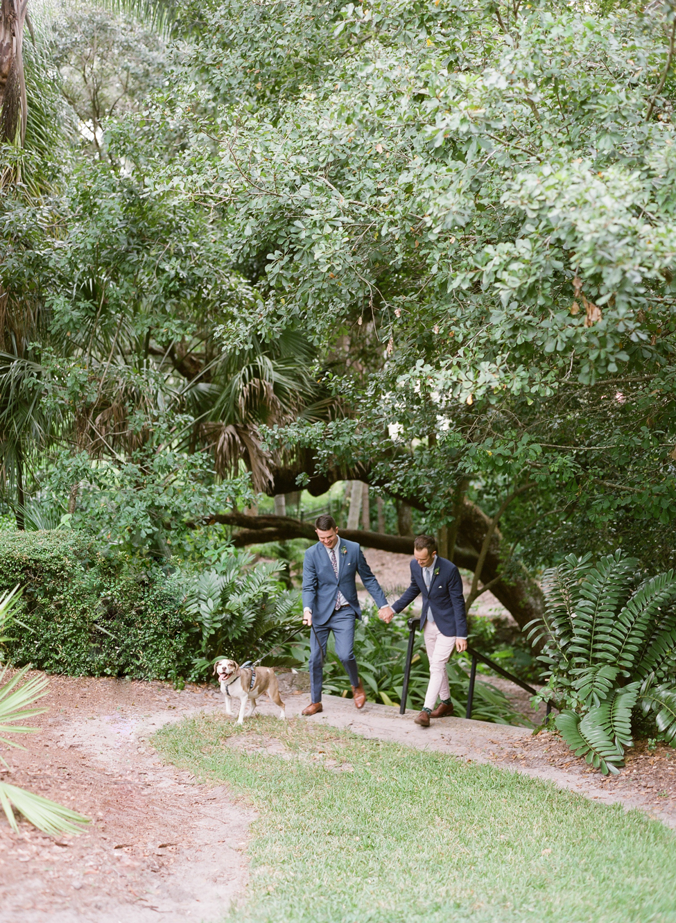 couple grooms processional with their dog