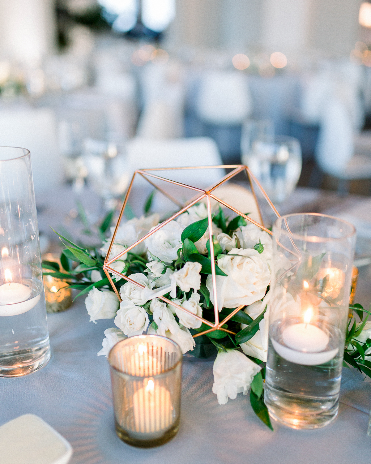 wedding centerpiece with roses and small candles