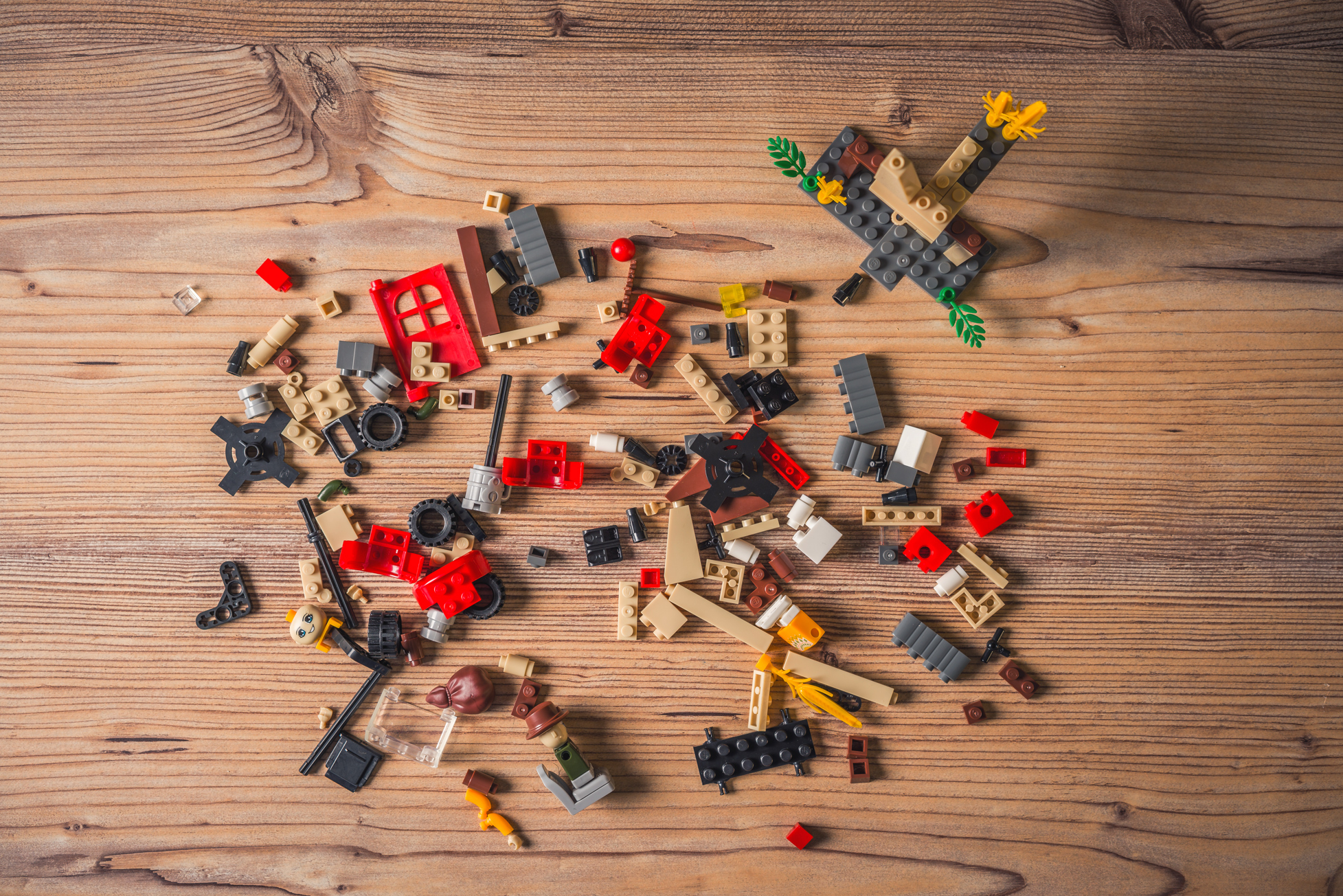 lego pieces scattered on wood floor