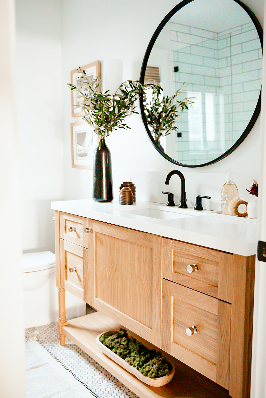 guest bathroom with black accents white walls