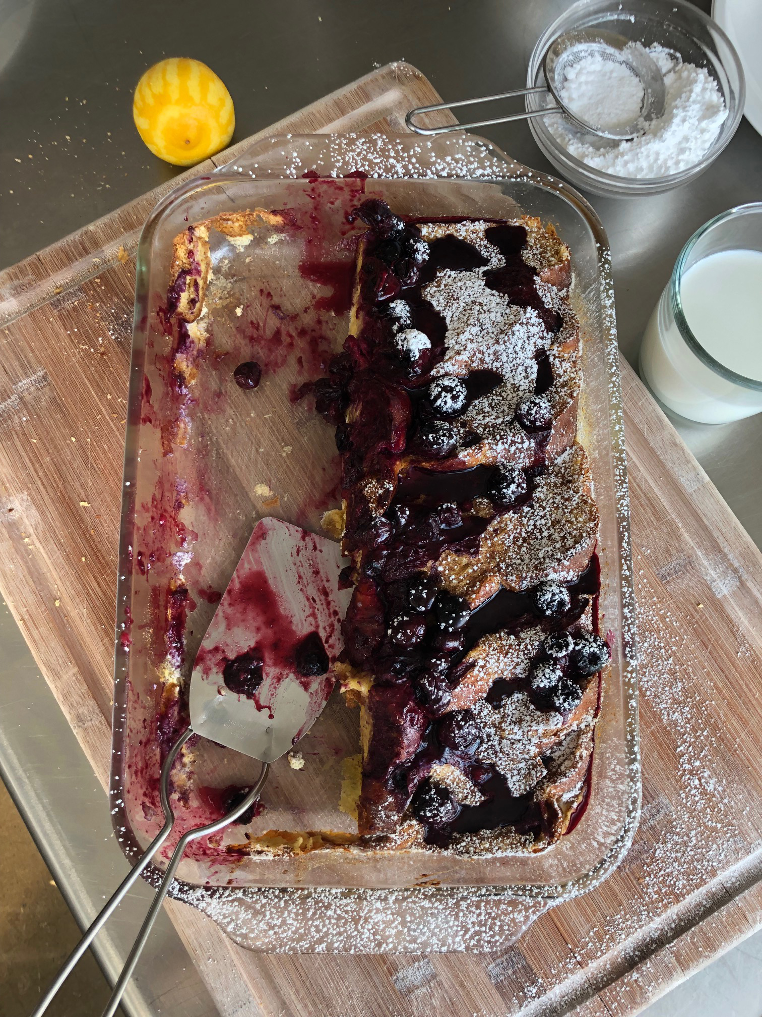 blintz french toast dessert with spatula and powdered sugar topping