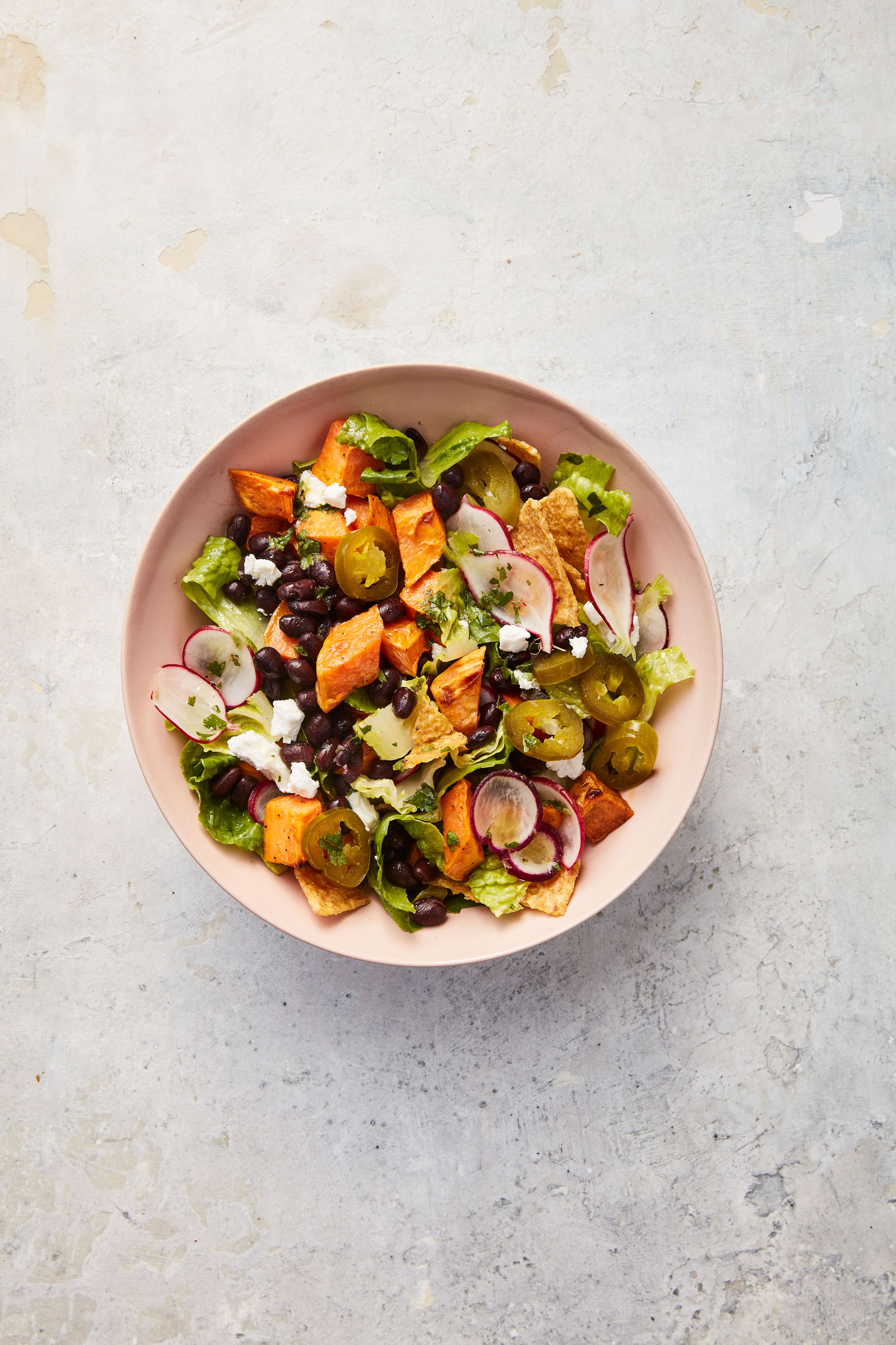 sweet potato taco salad served in pink bowl