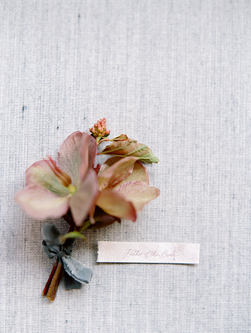 mauve-colored boutonniere