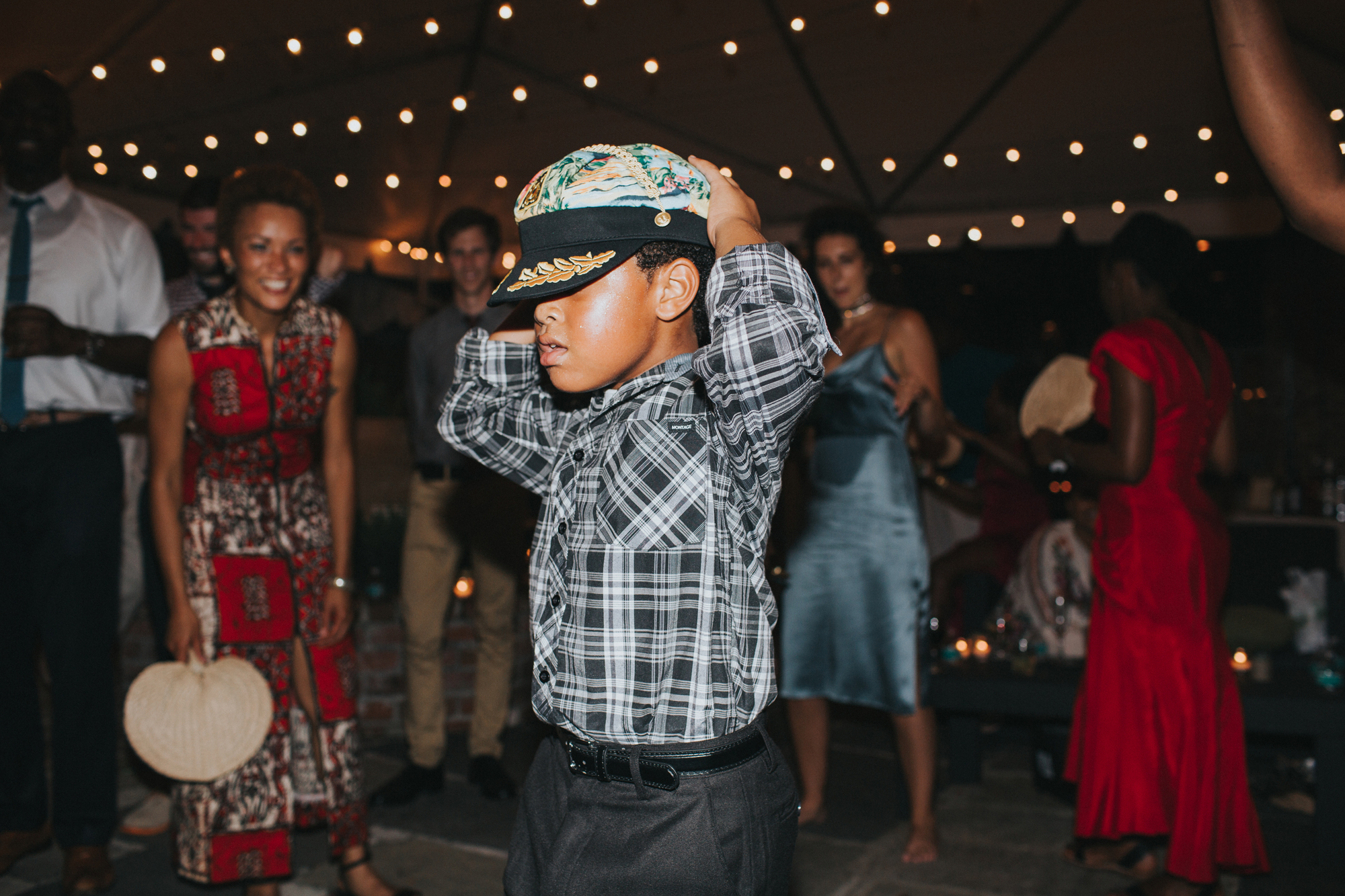 boy wearing boating hat dancing