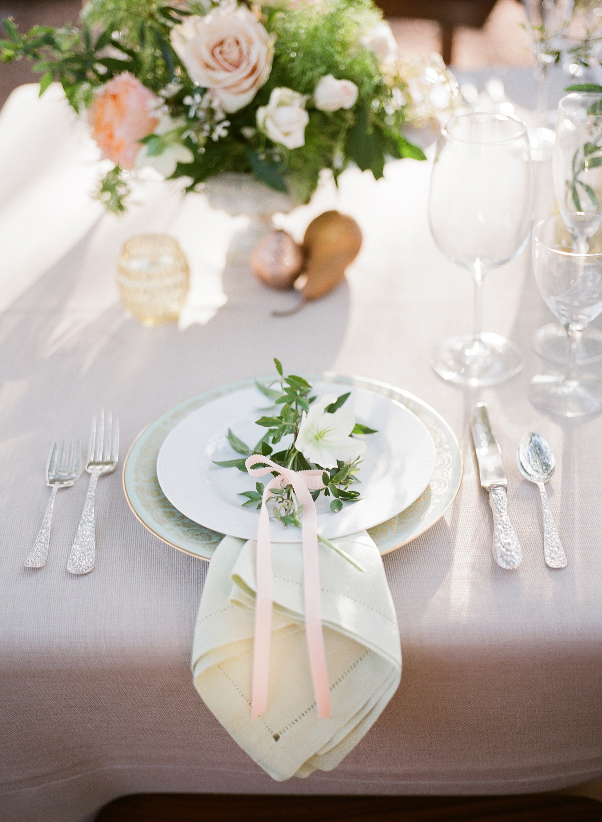 wedding reception napkin folds pointed waterfall fold beneath plate with flowers