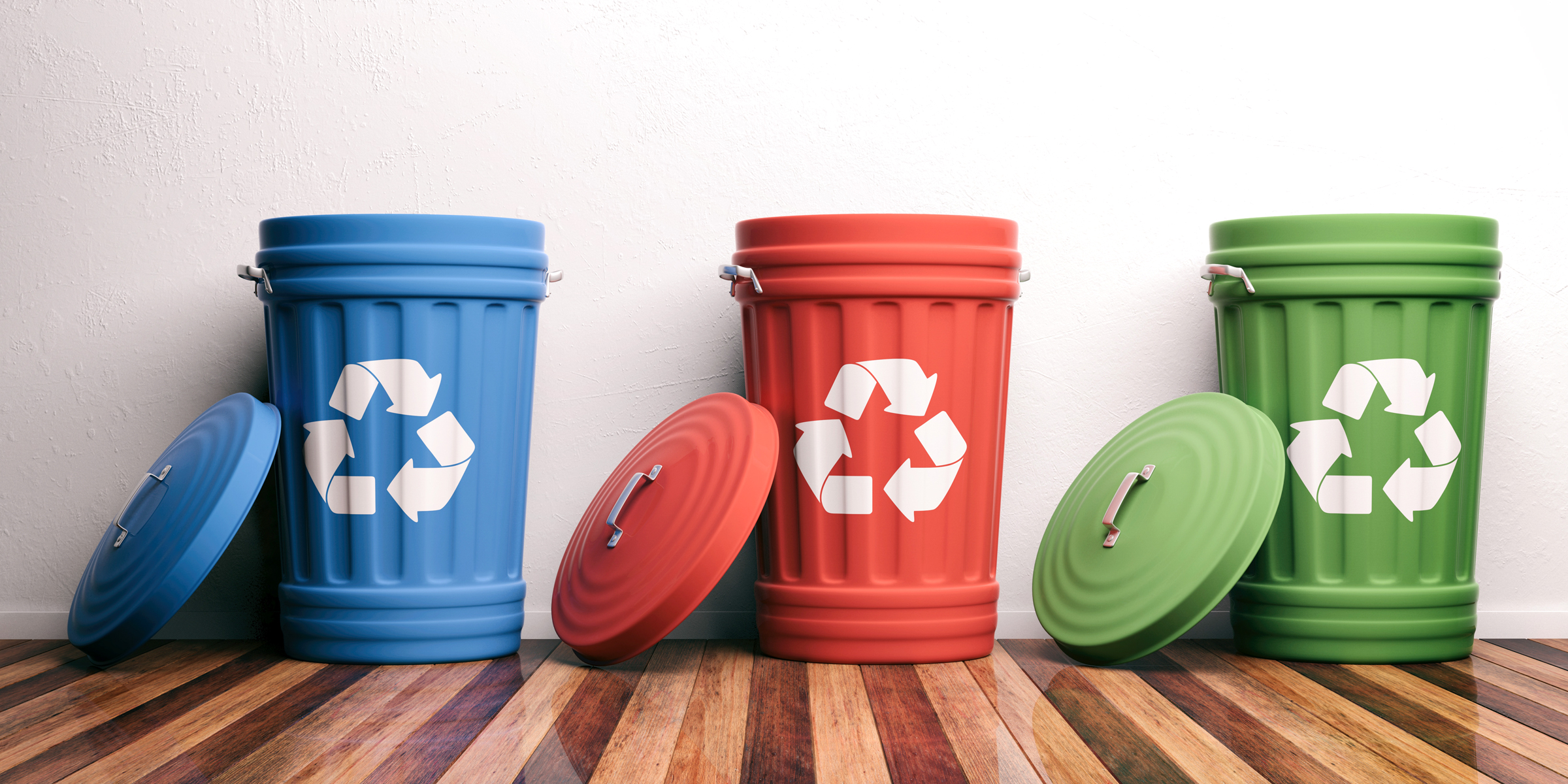thee multi-colored recycling bins
