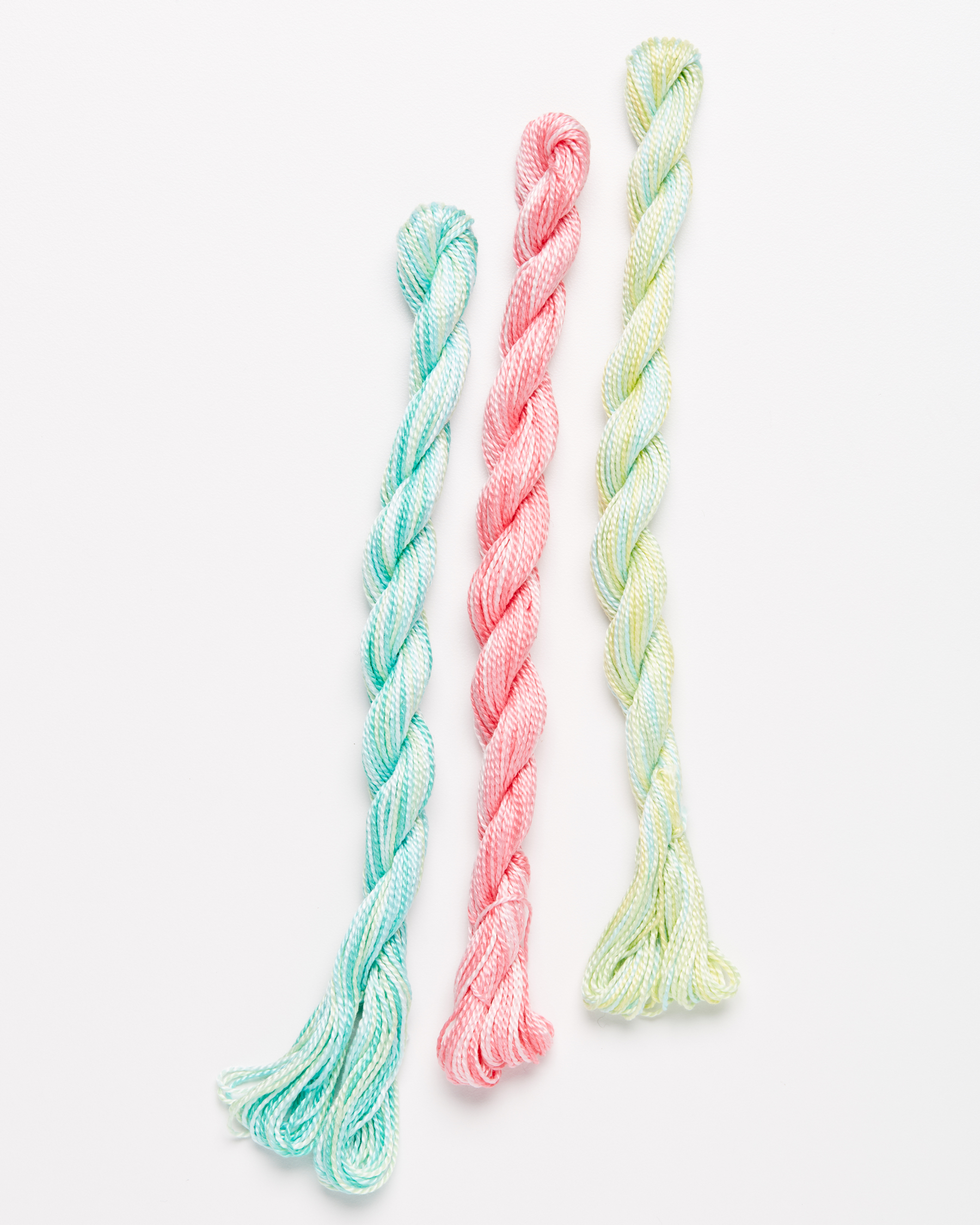 pastel variegated embroidery yarn against a white background