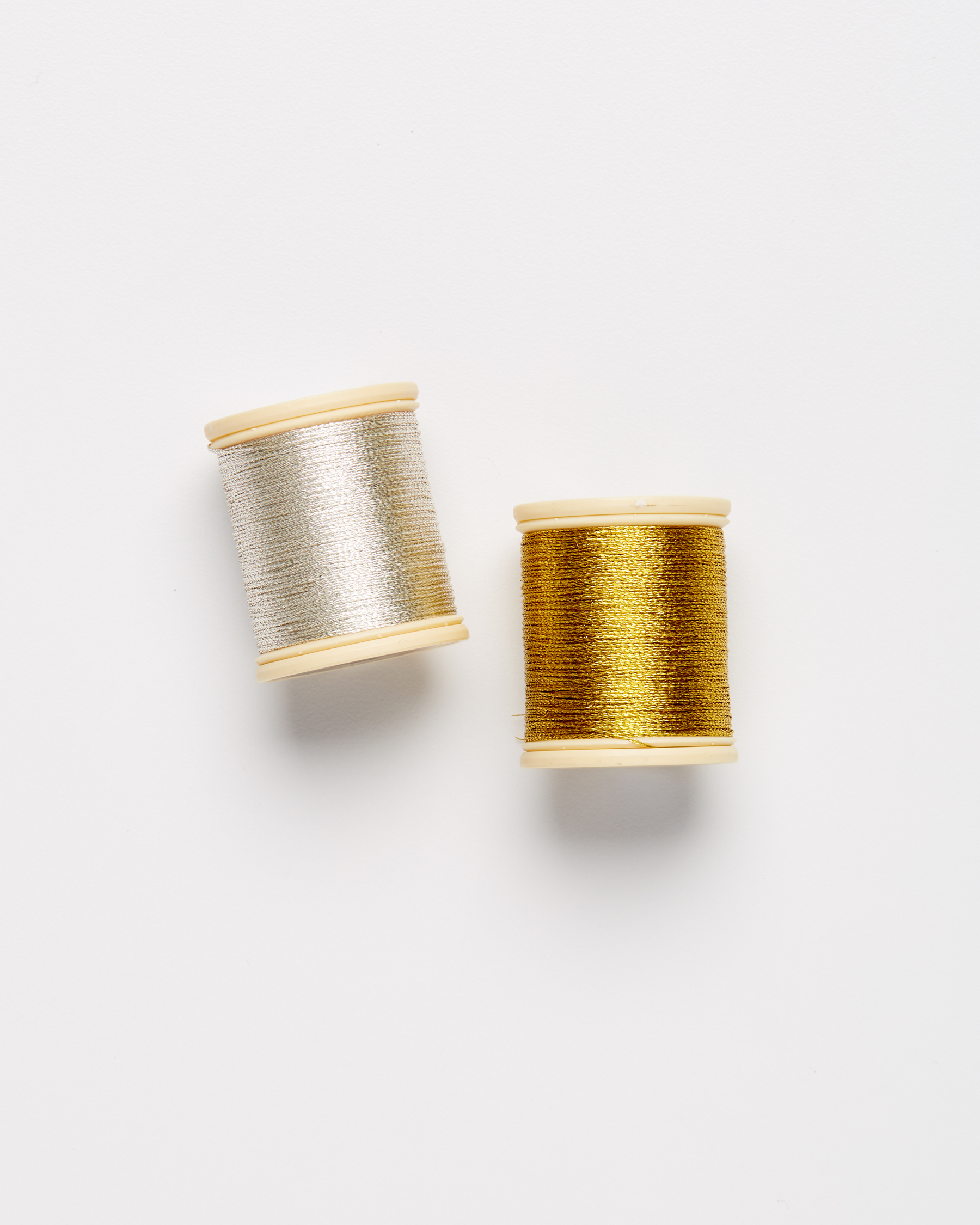 two spools of metallic embroidery thread