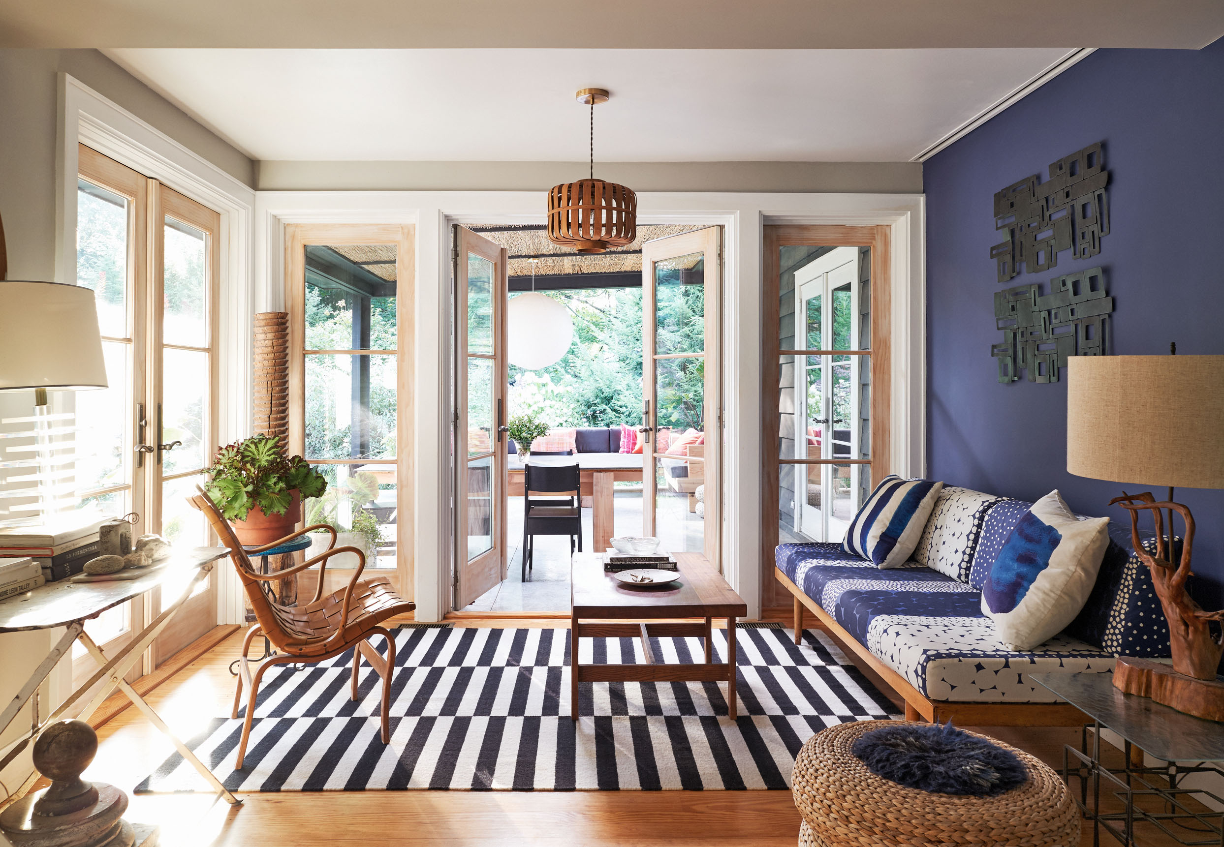 living room with black and white rug and patio