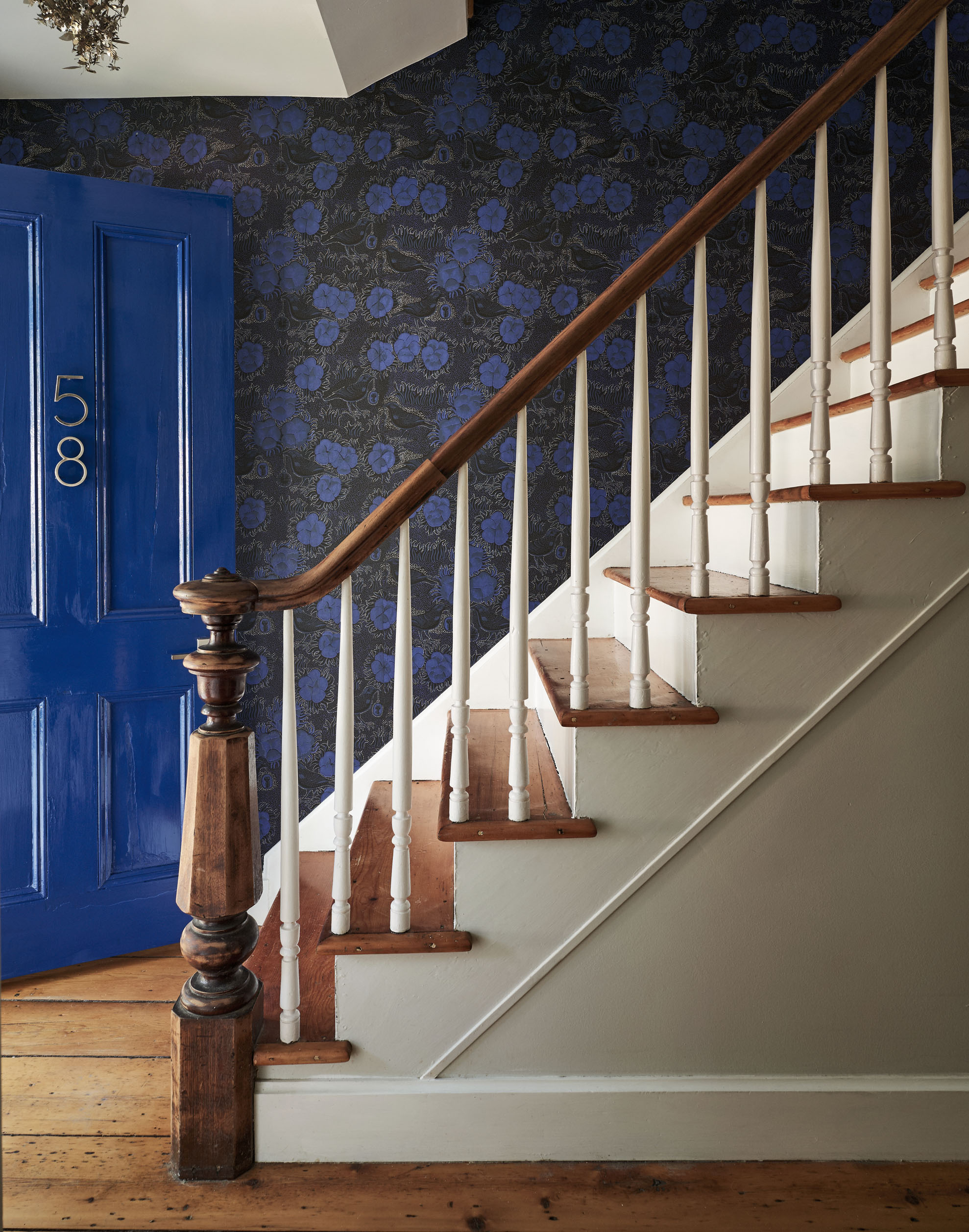 original staircase with blue front door