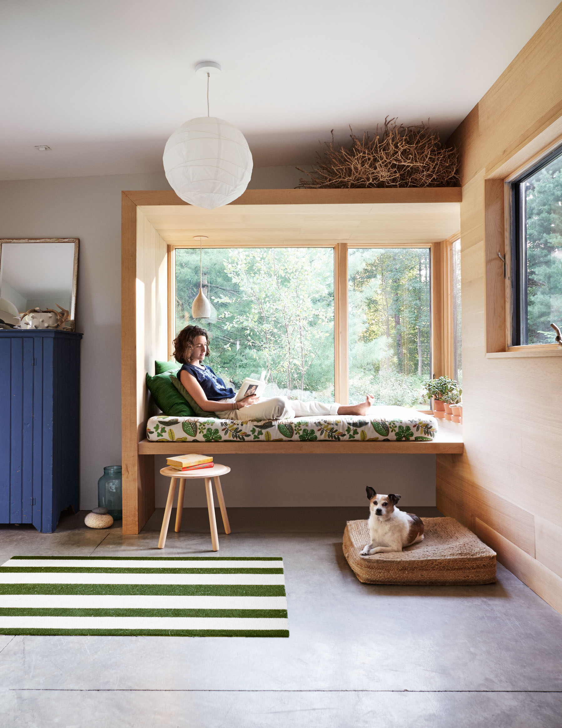 woman sitting in window seat in mudroom