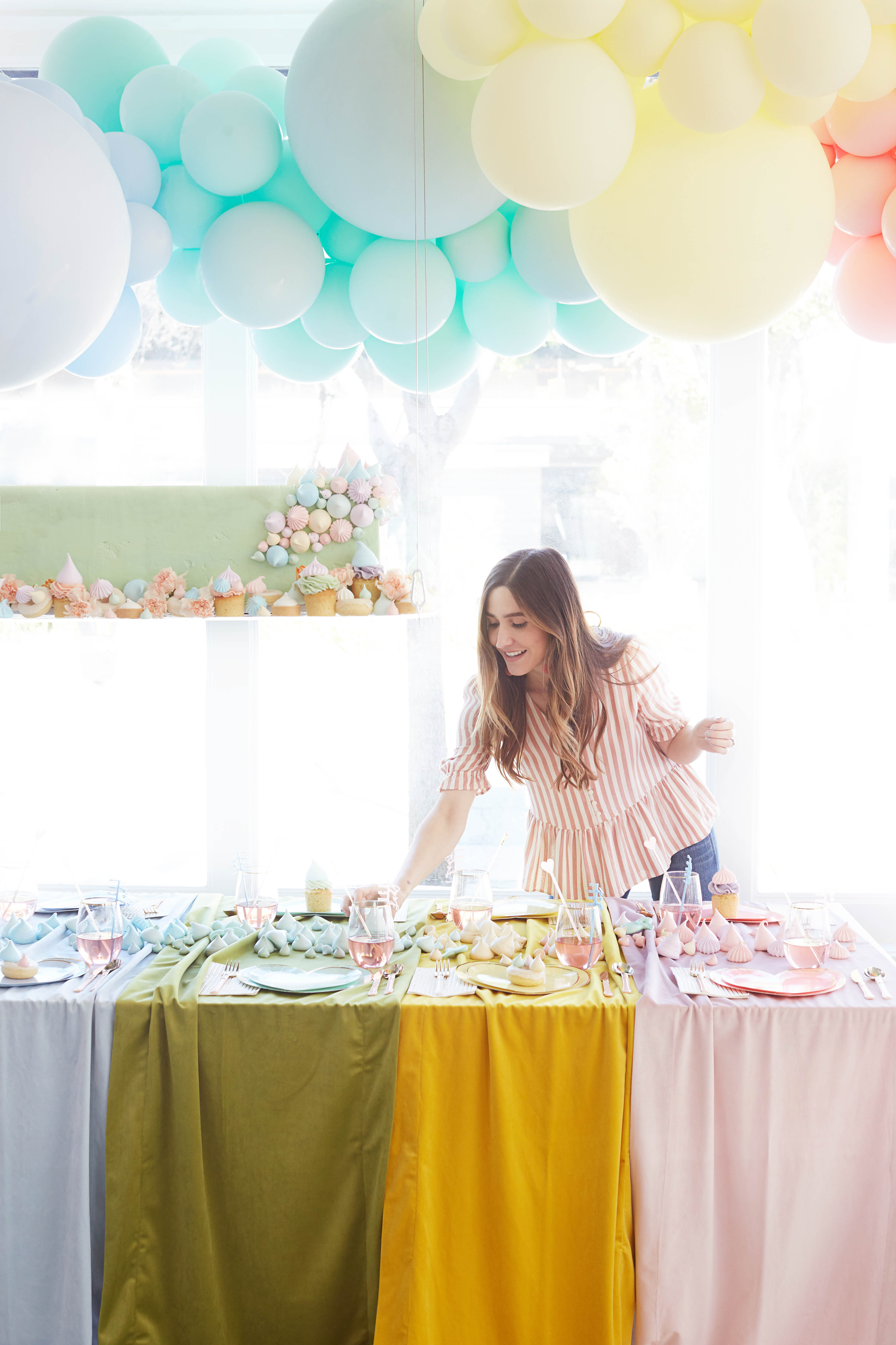 rainbow baby shower place settings and balloons