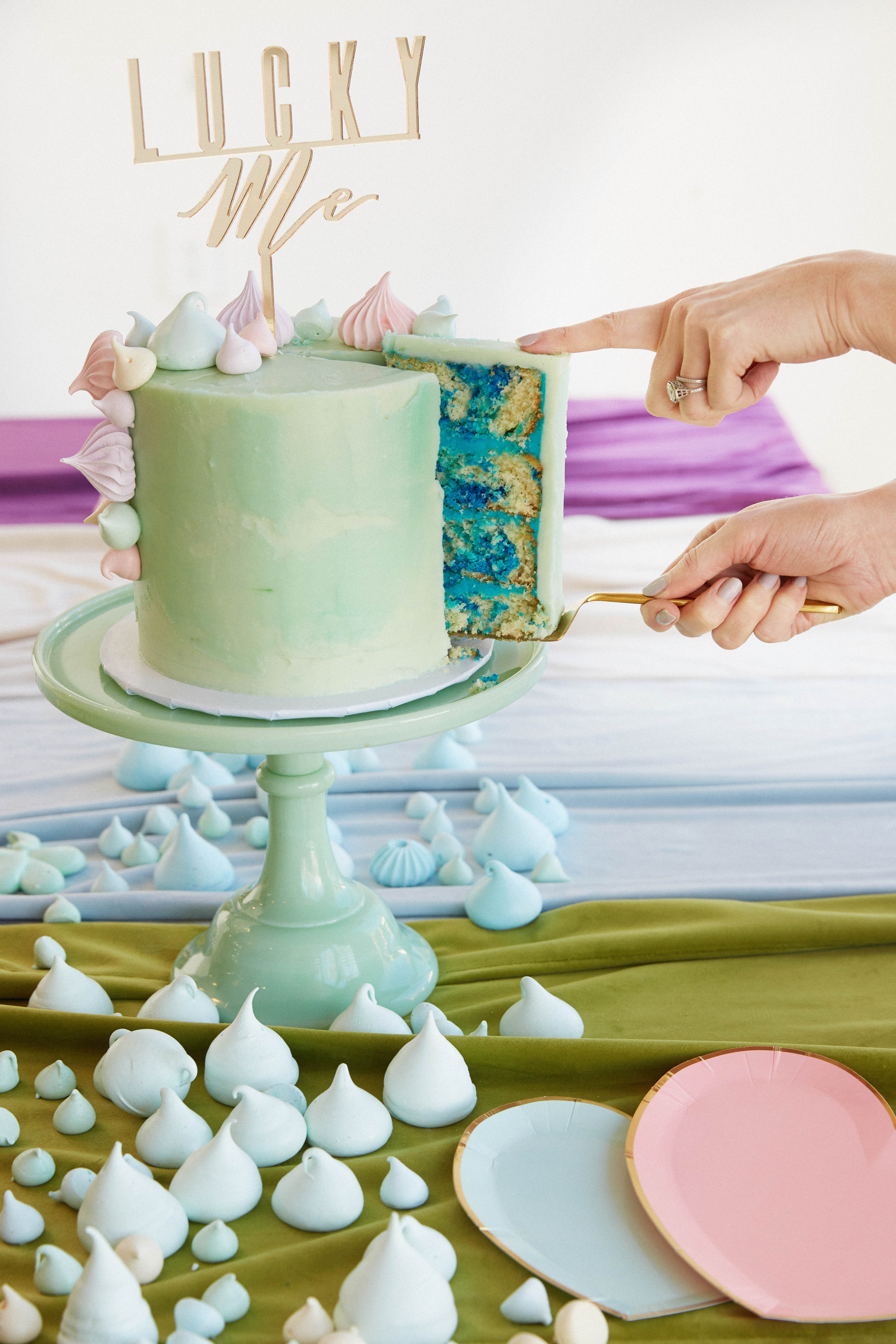 cake getting cut at baby shower