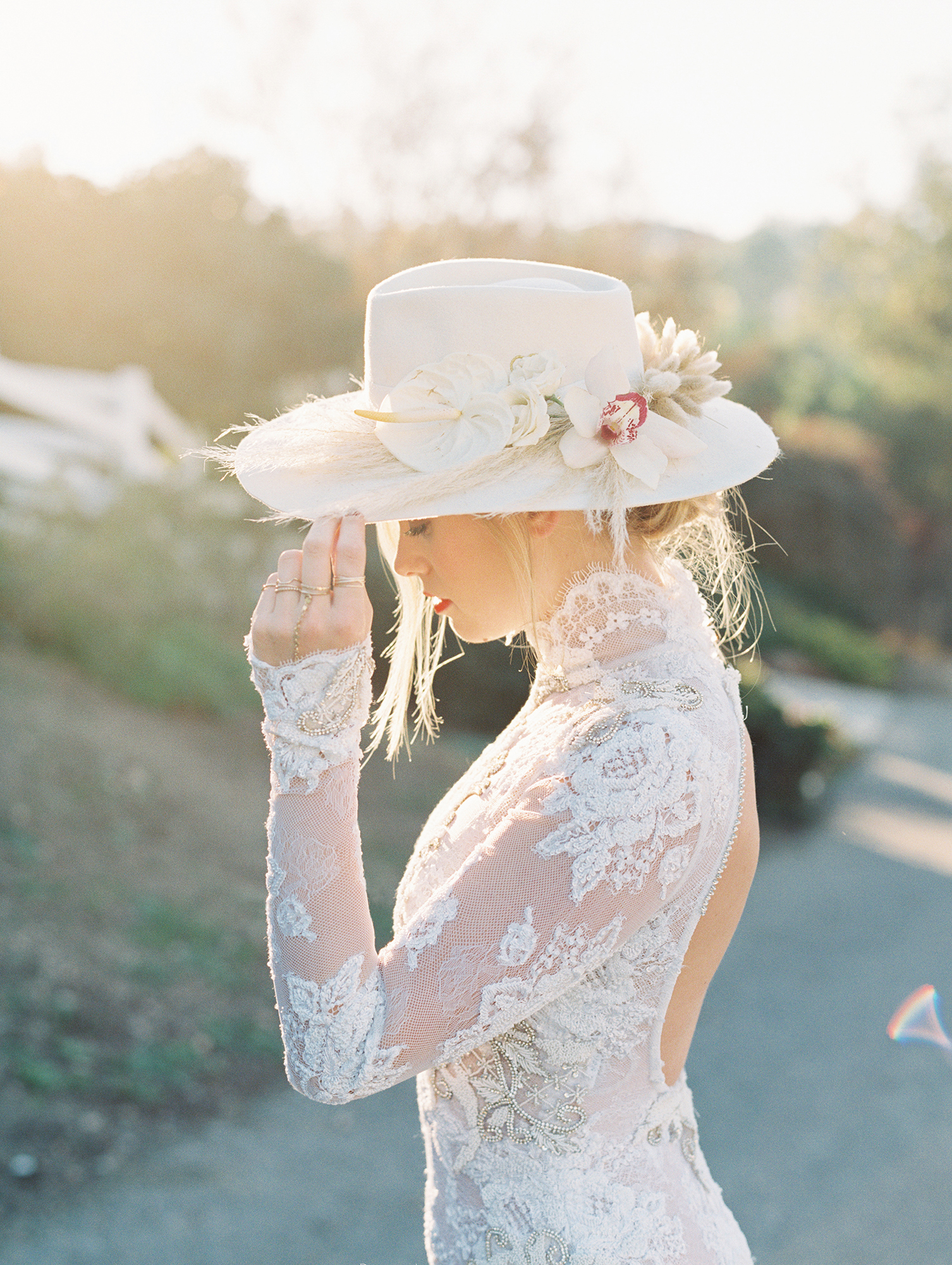 bride wearing hat with flowers
