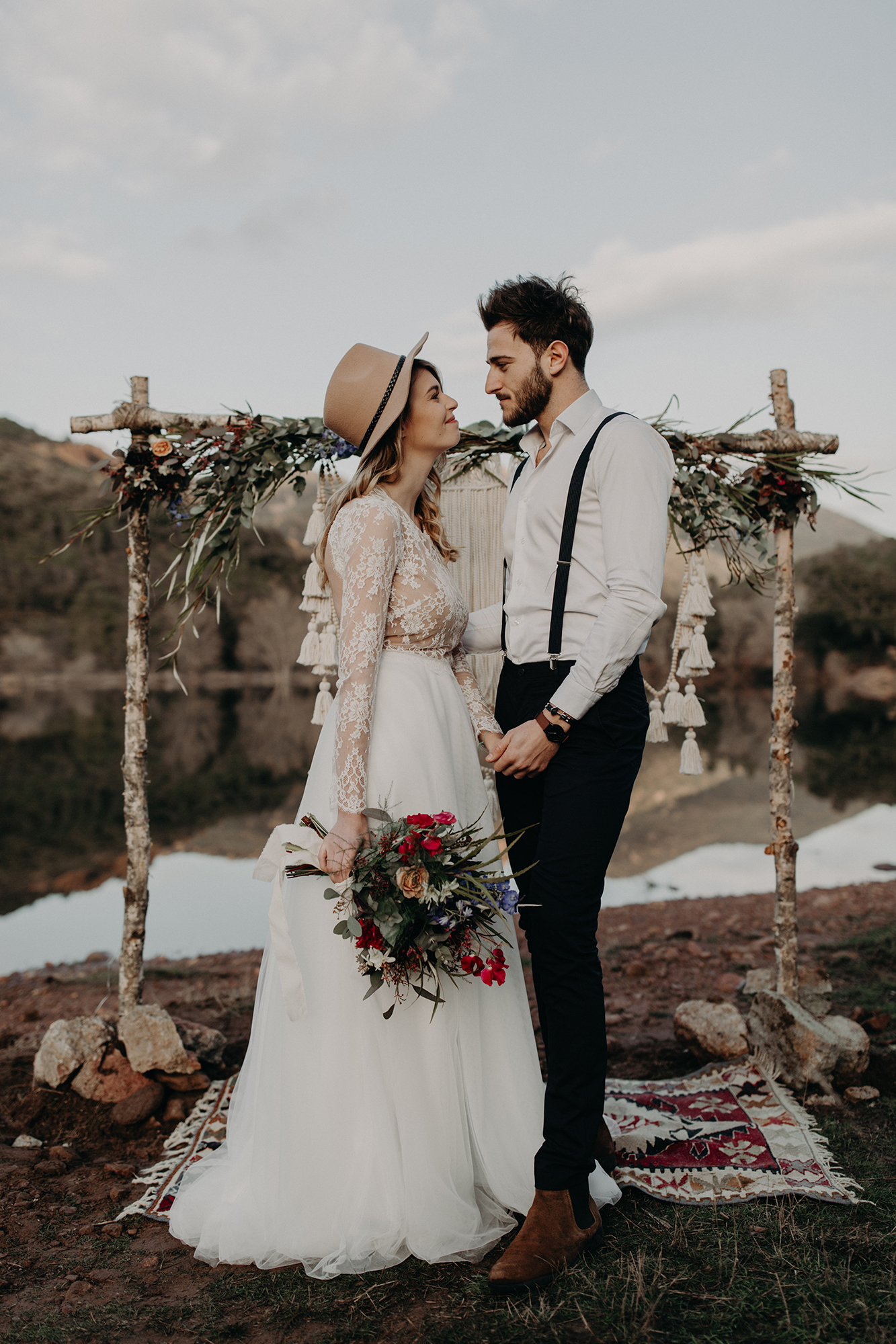 bride wearing hat and long sleeve gown