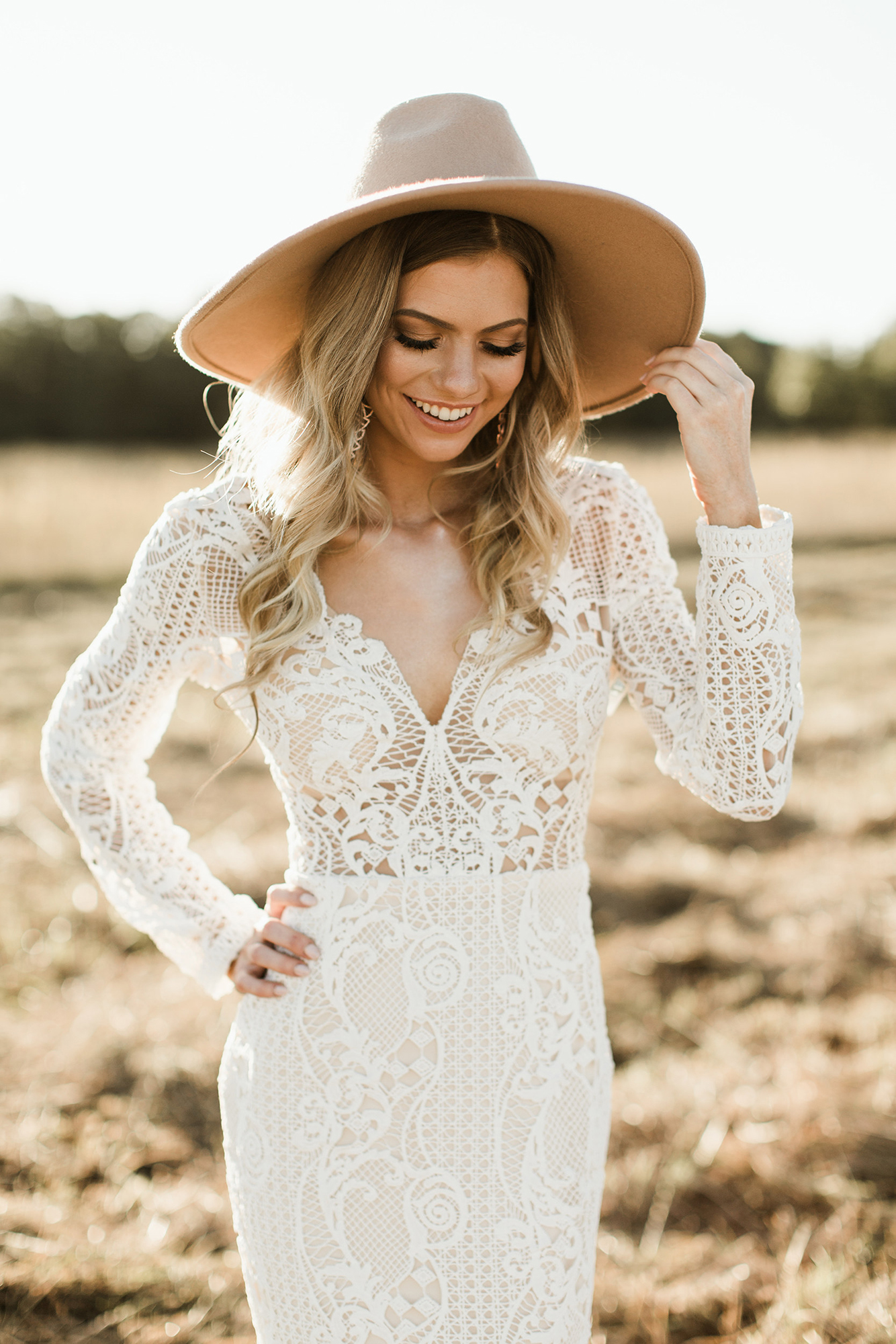 bride wearing tan hat
