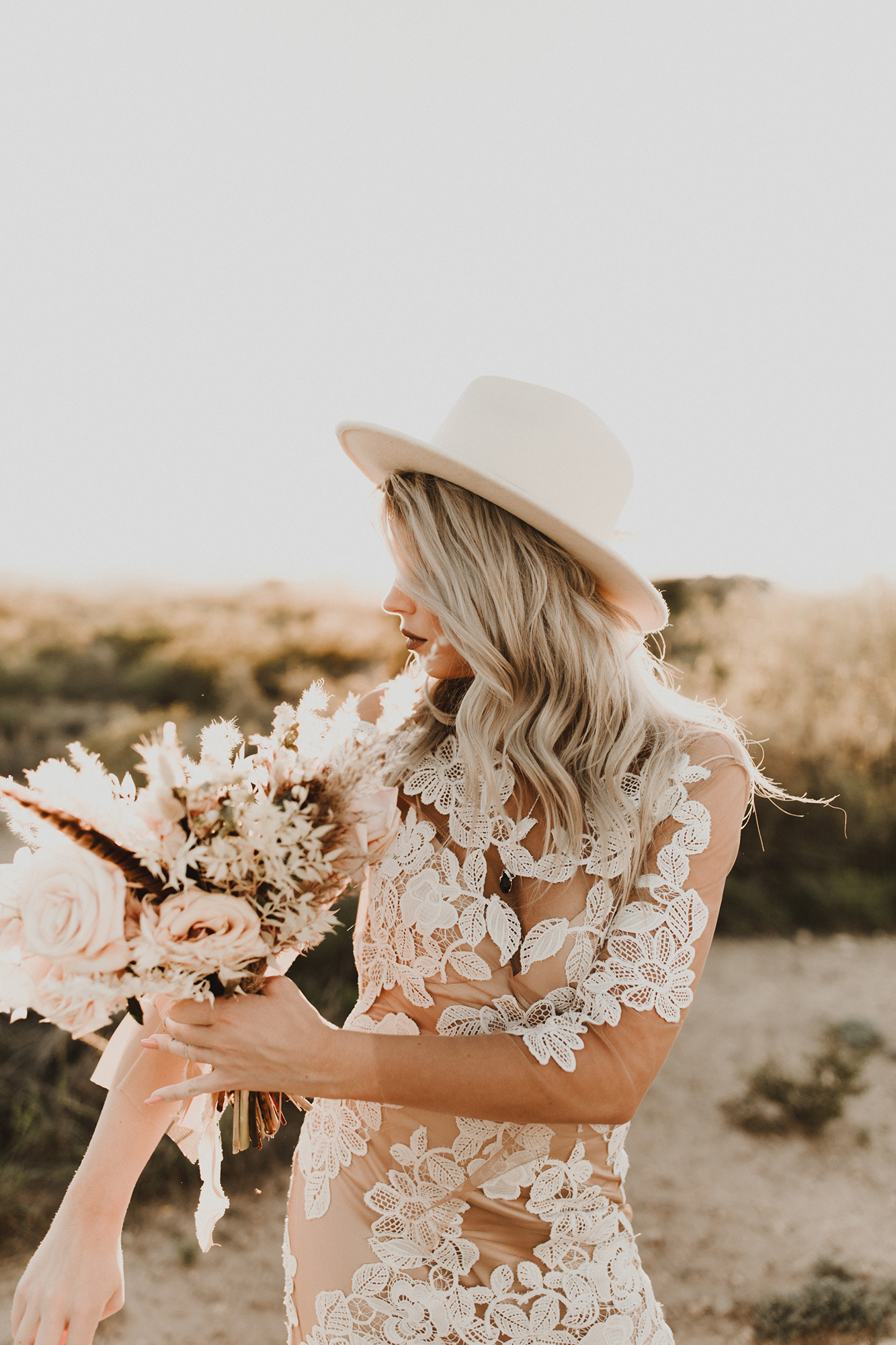 bride wearing white hat and lipstick