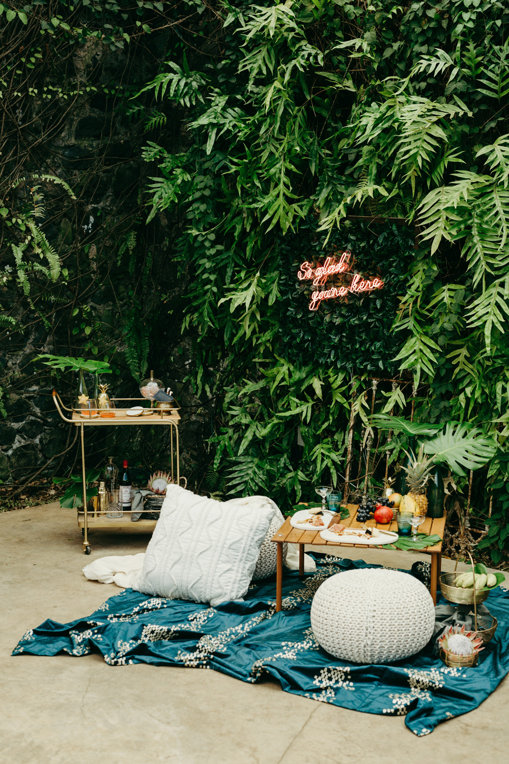 wedding plant wall tropical foliage and a neon sign