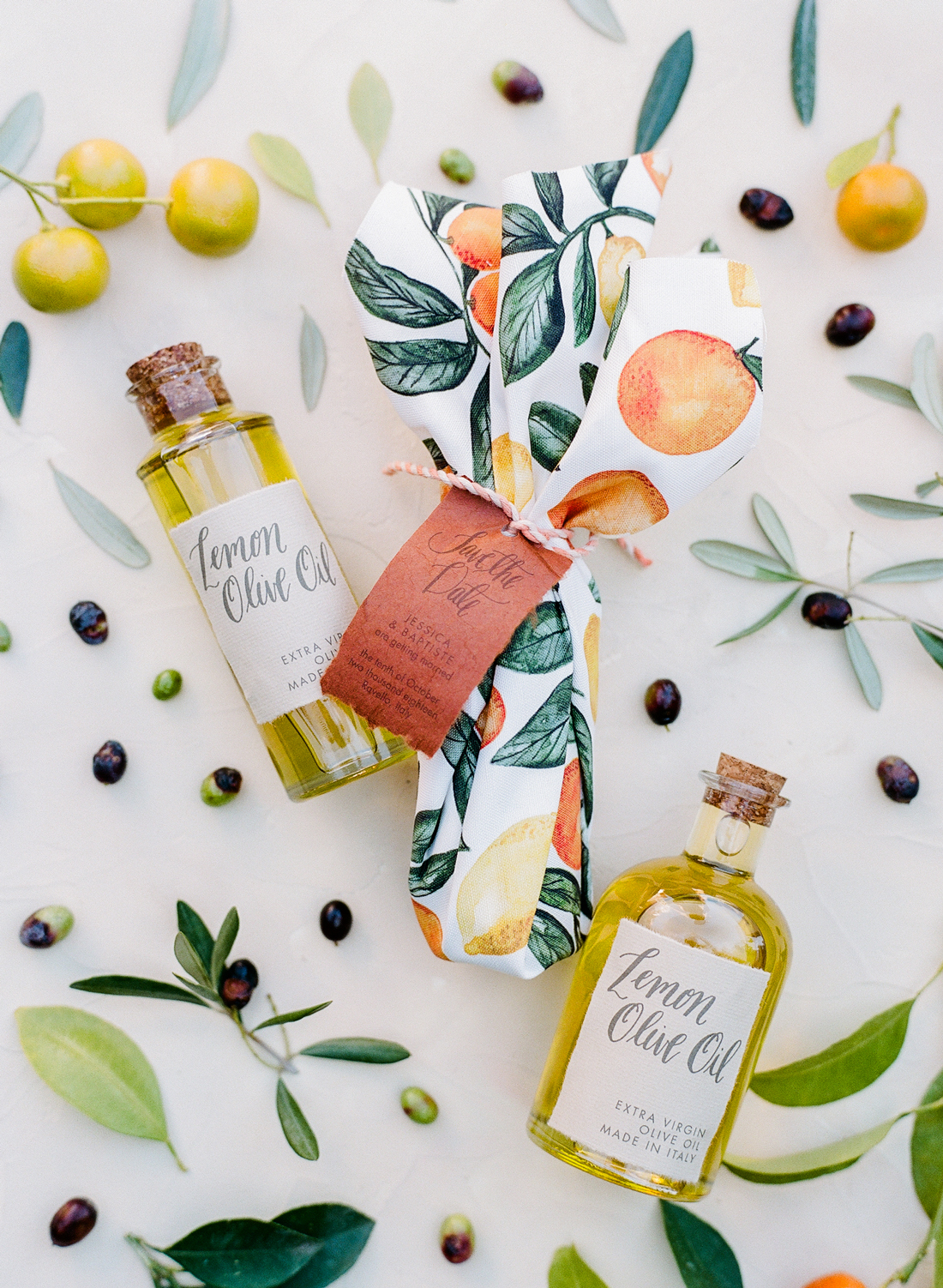 olive oil save the dates wrapped in custom citrus design linens