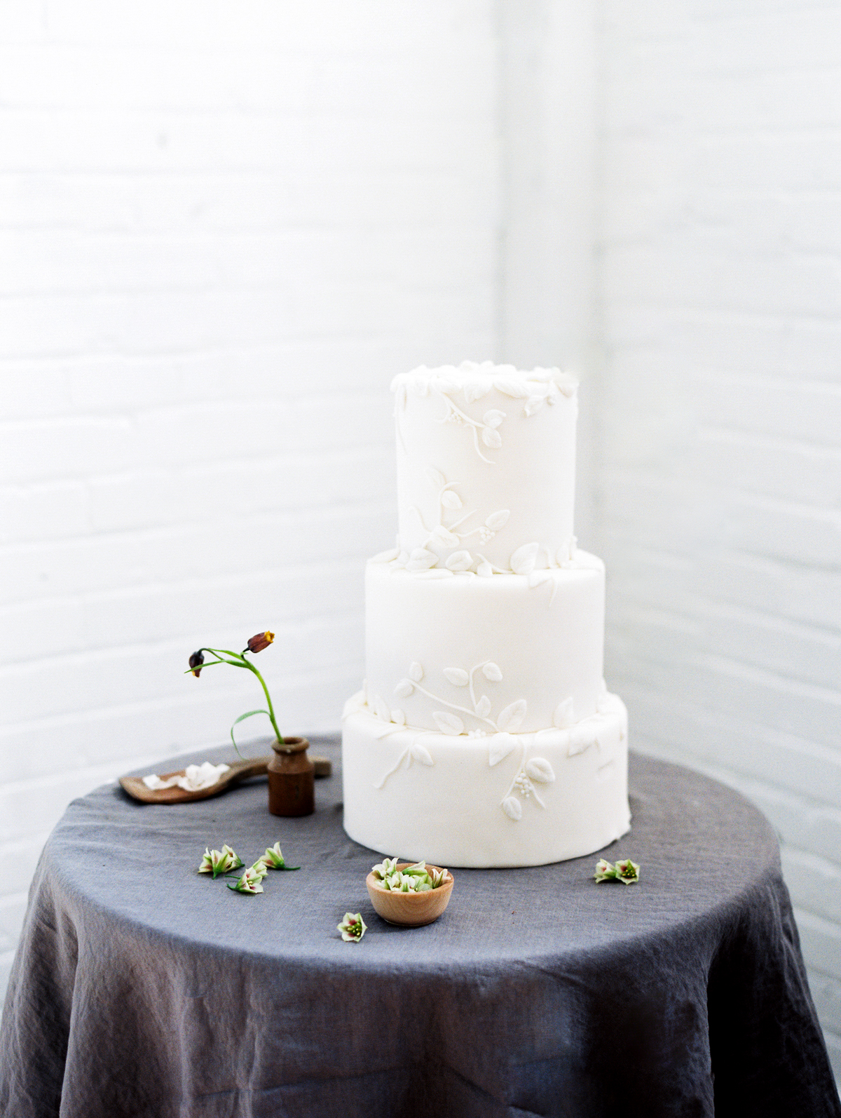 three tiered white wedding cake with frosted floral design