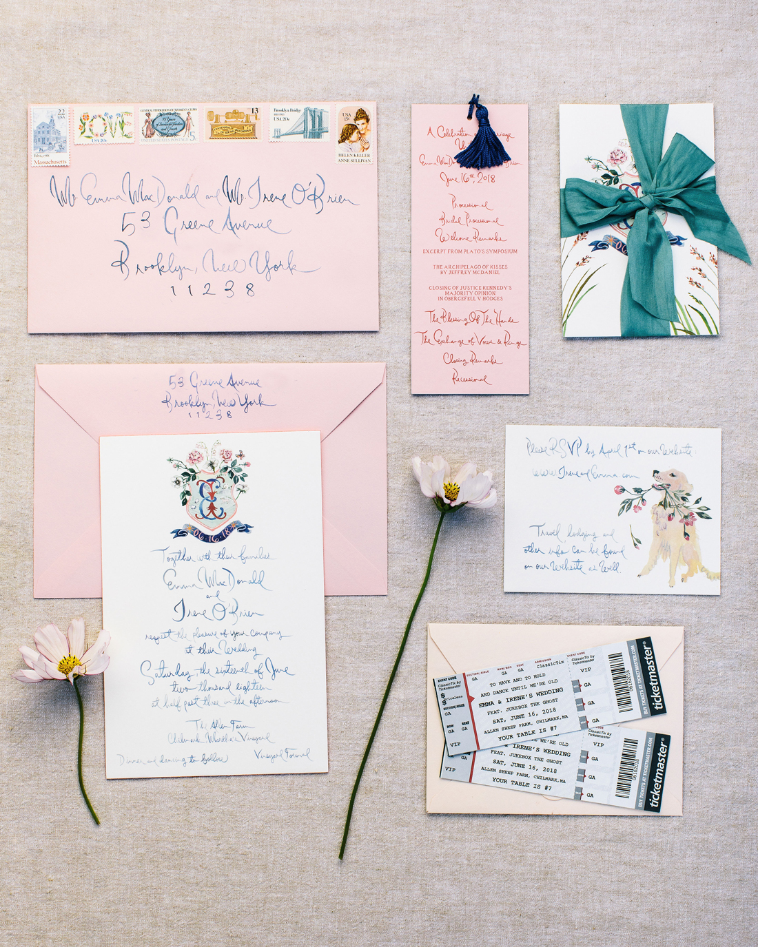 pink and white invitation suit with blue writing