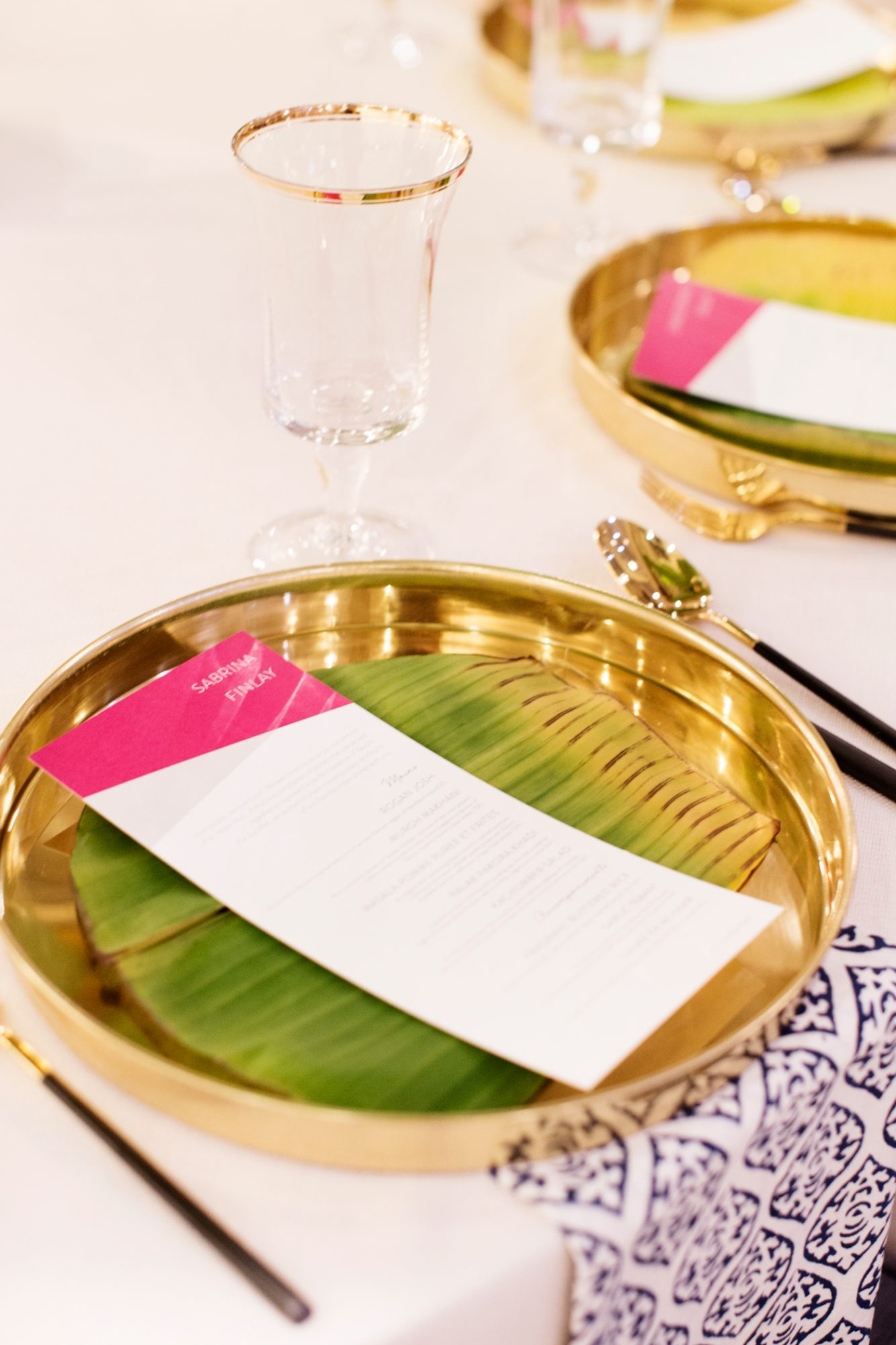 circular gold place settings for traditional thali-style dinner