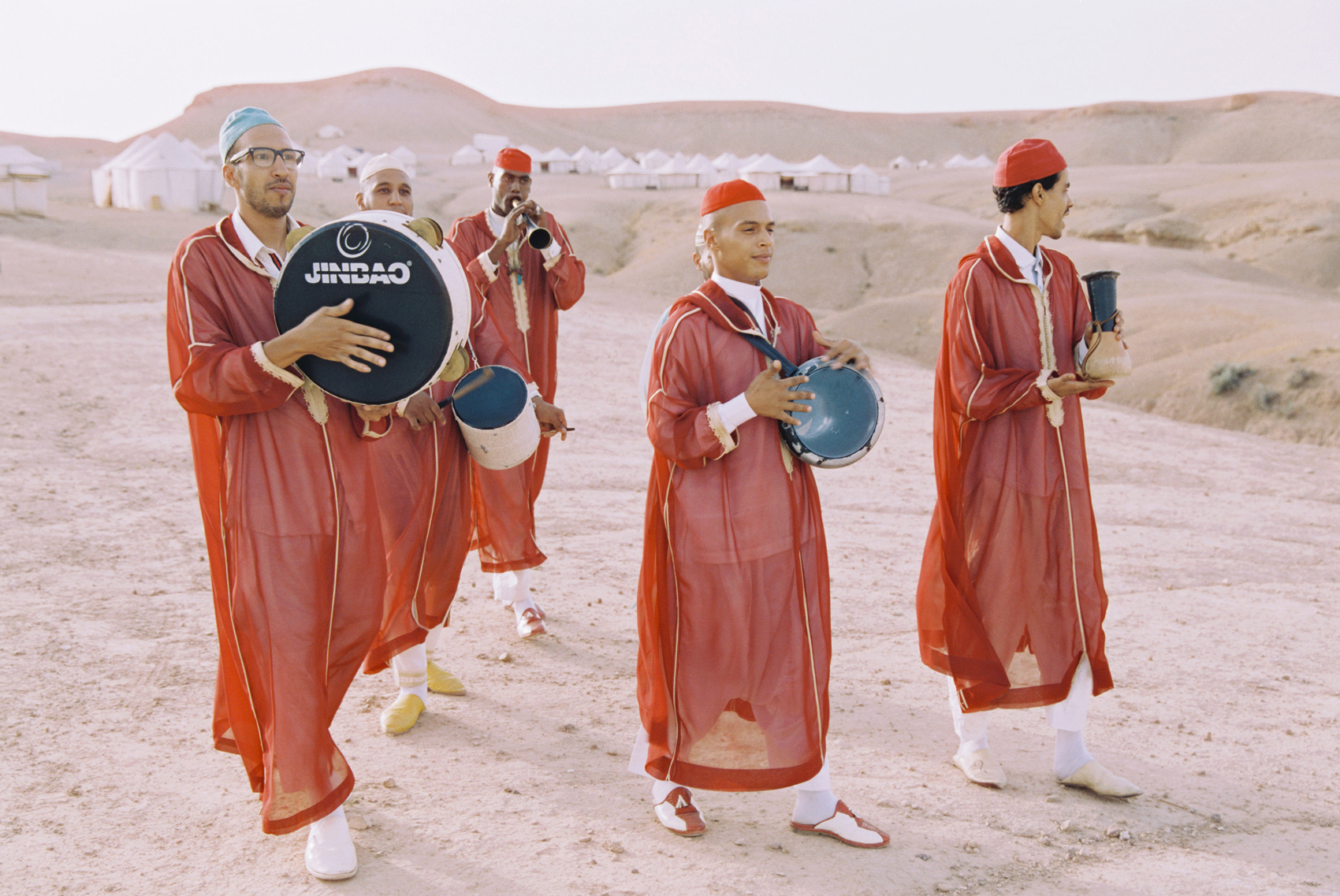 traditional live moroccan band wearing red and white attire