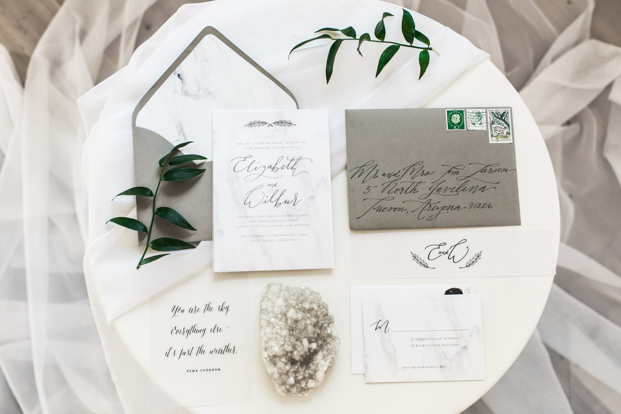 gray and white stationary suit wedding invites with marble accents