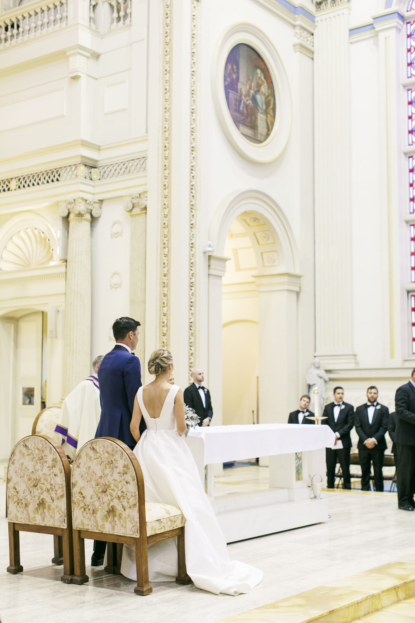 bride and groom standing at church alter during ceremony