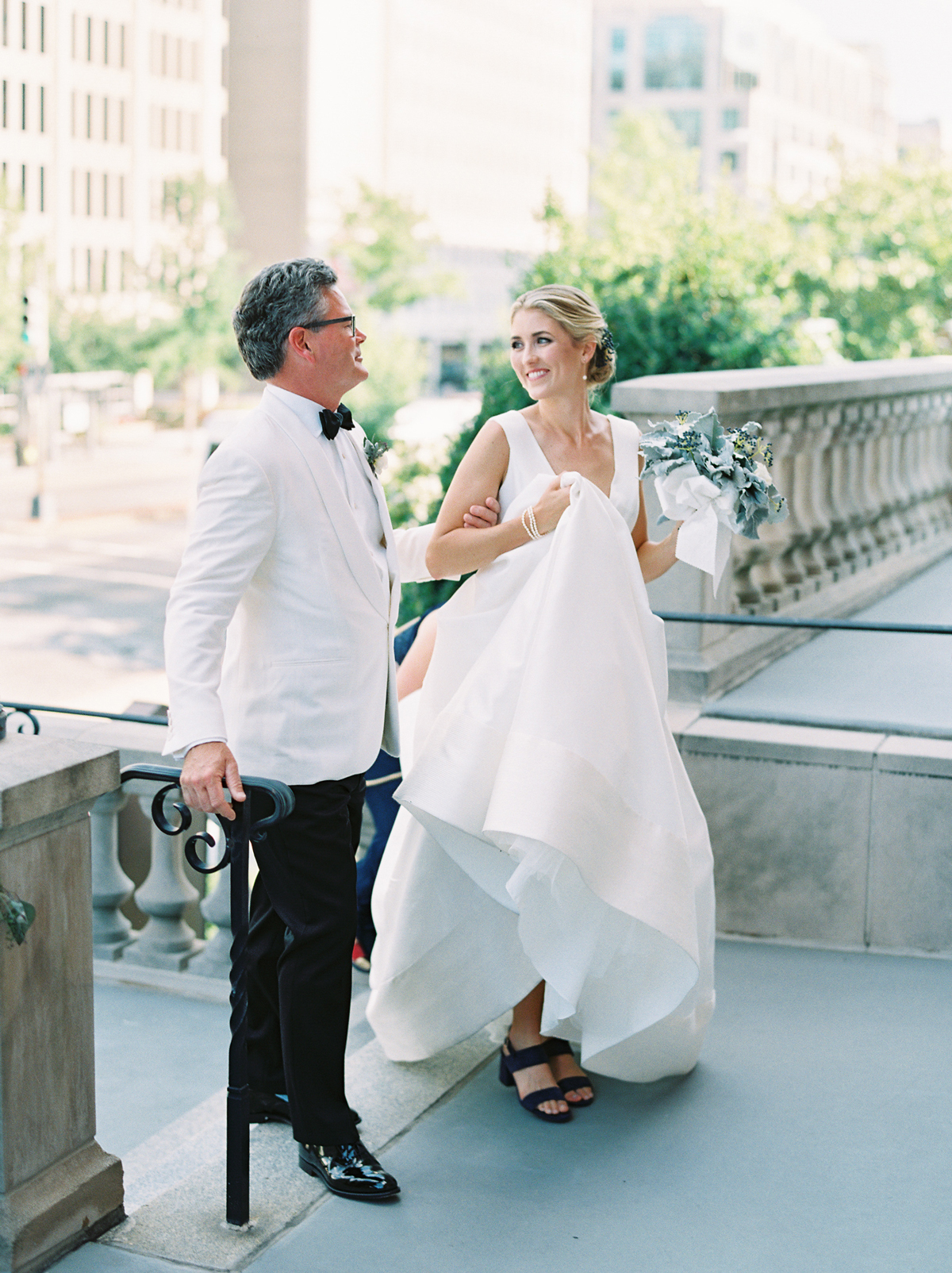 bride with father before walking down wedding aisle