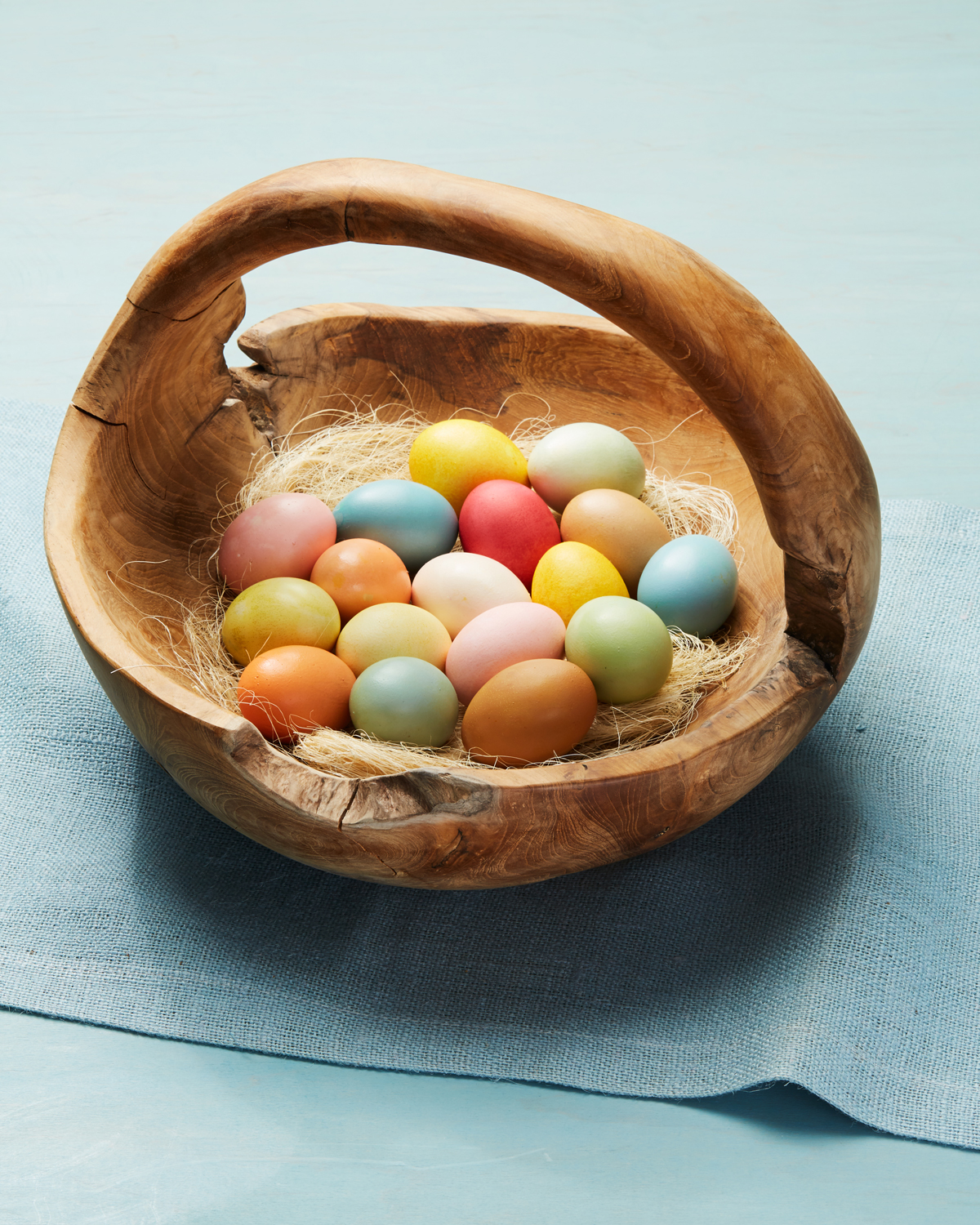 naturally dyed easter eggs in a wooden basket