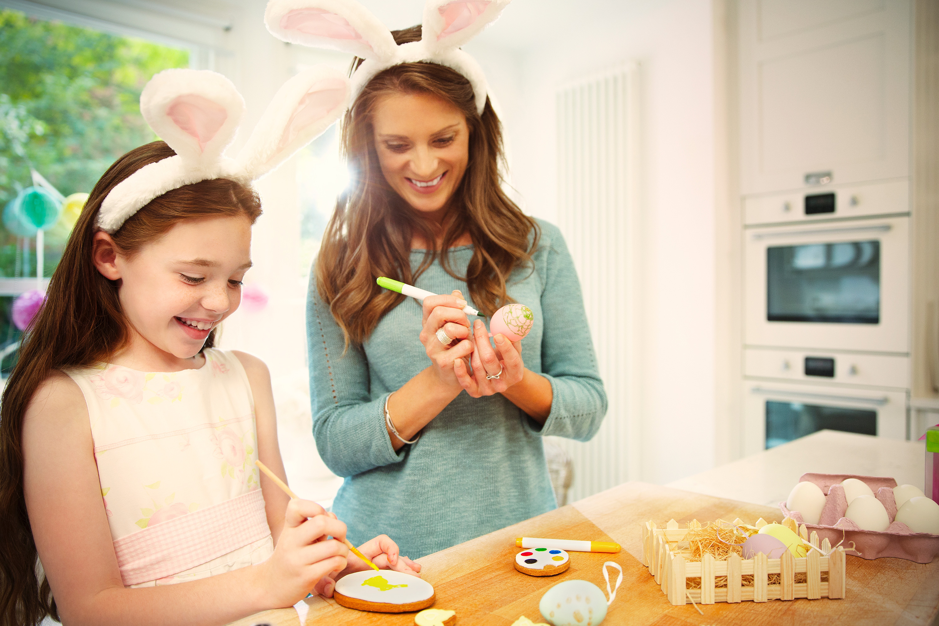 mom and daughter decorating Easter eggs