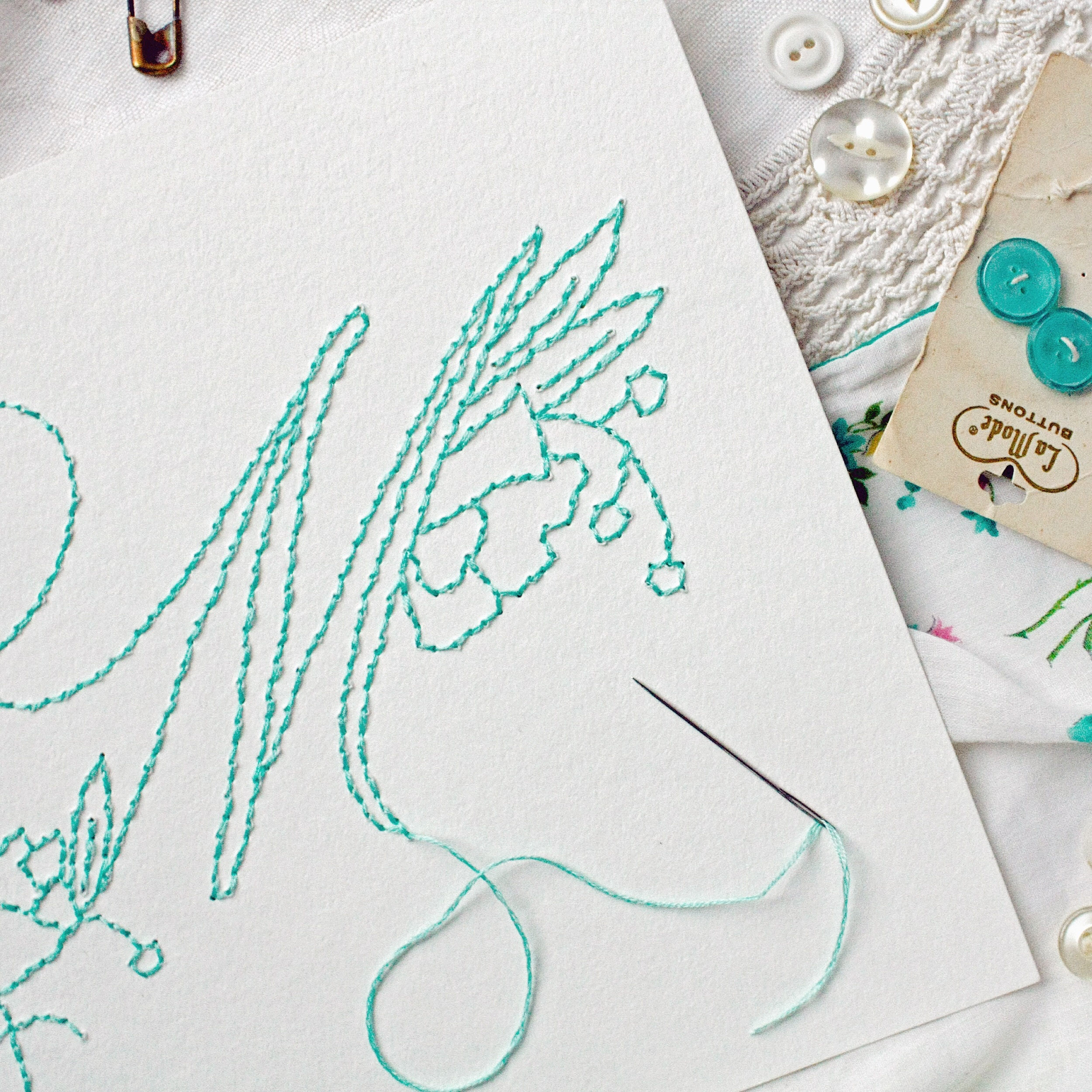 stitching embroidered monogram with needle & thread
