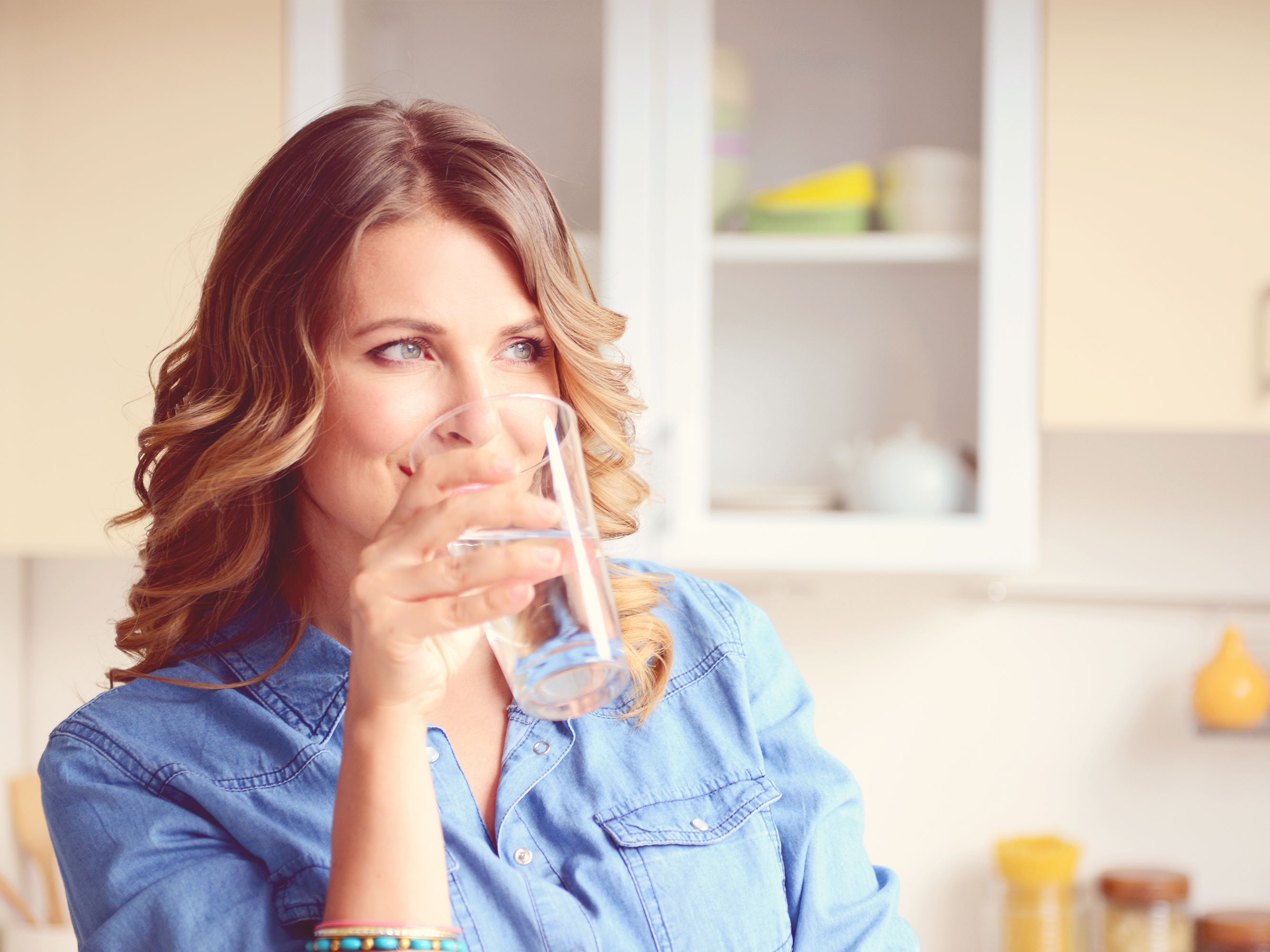 woman drinking tap water