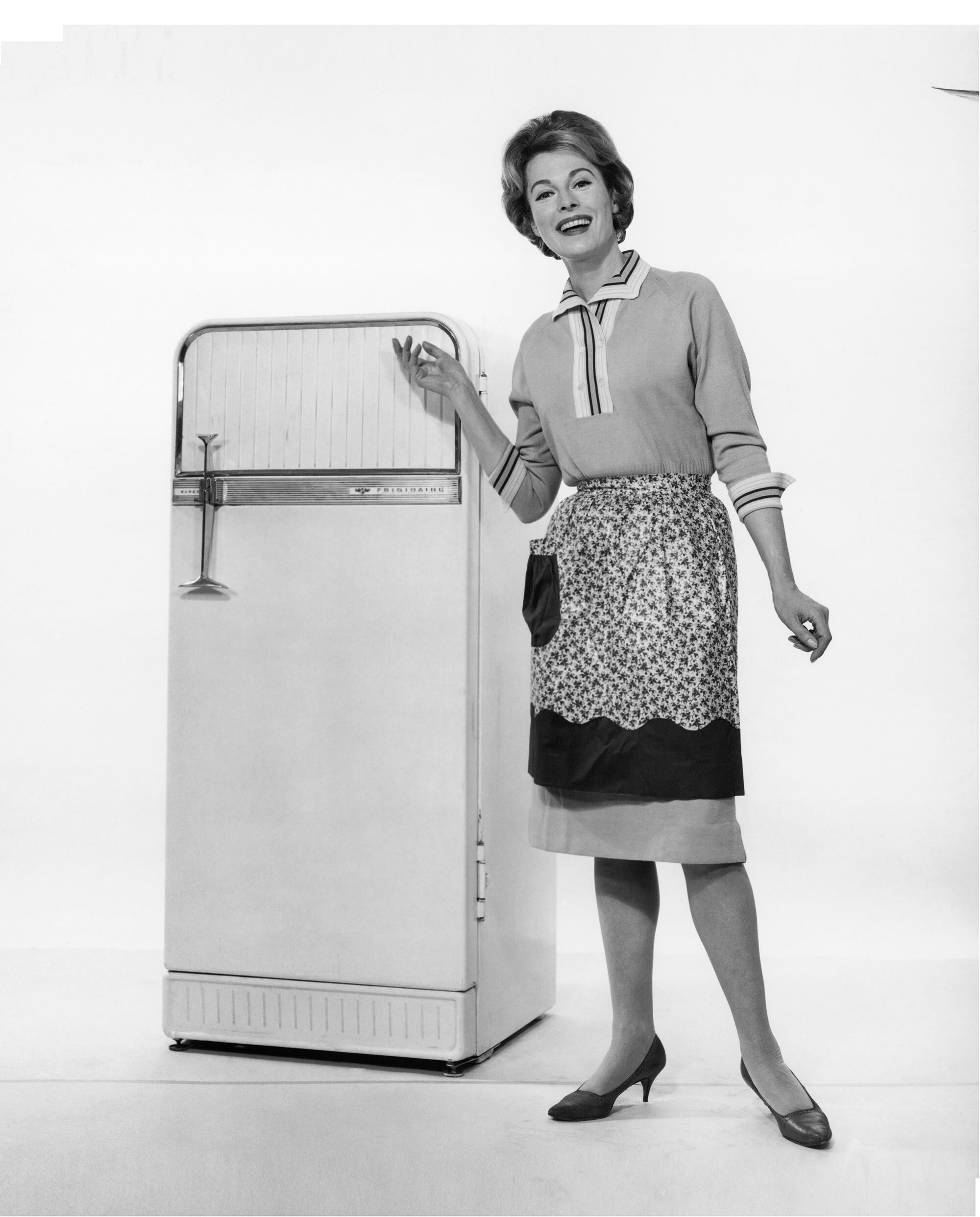 woman posing in front of vintage fridge