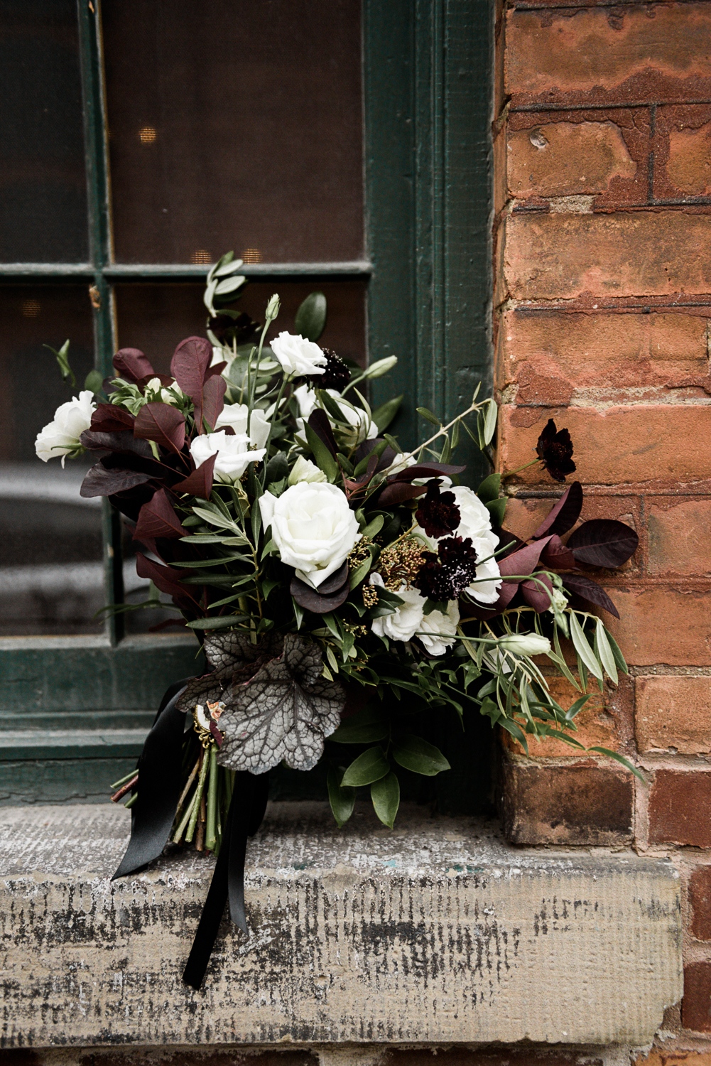 bouquet of burgundy florals and lots of greenery