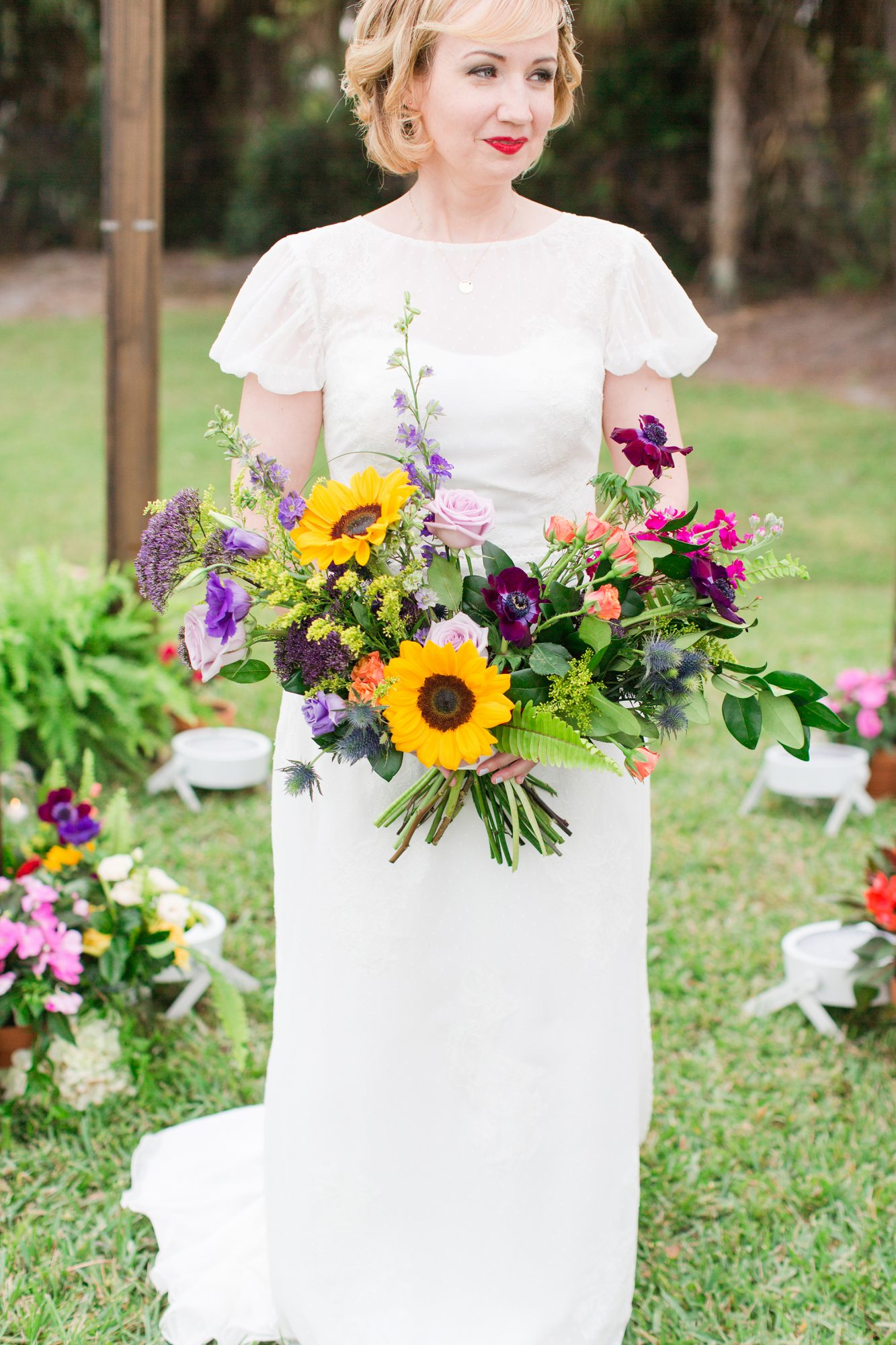 sunflower bouquet with roses and anemones
