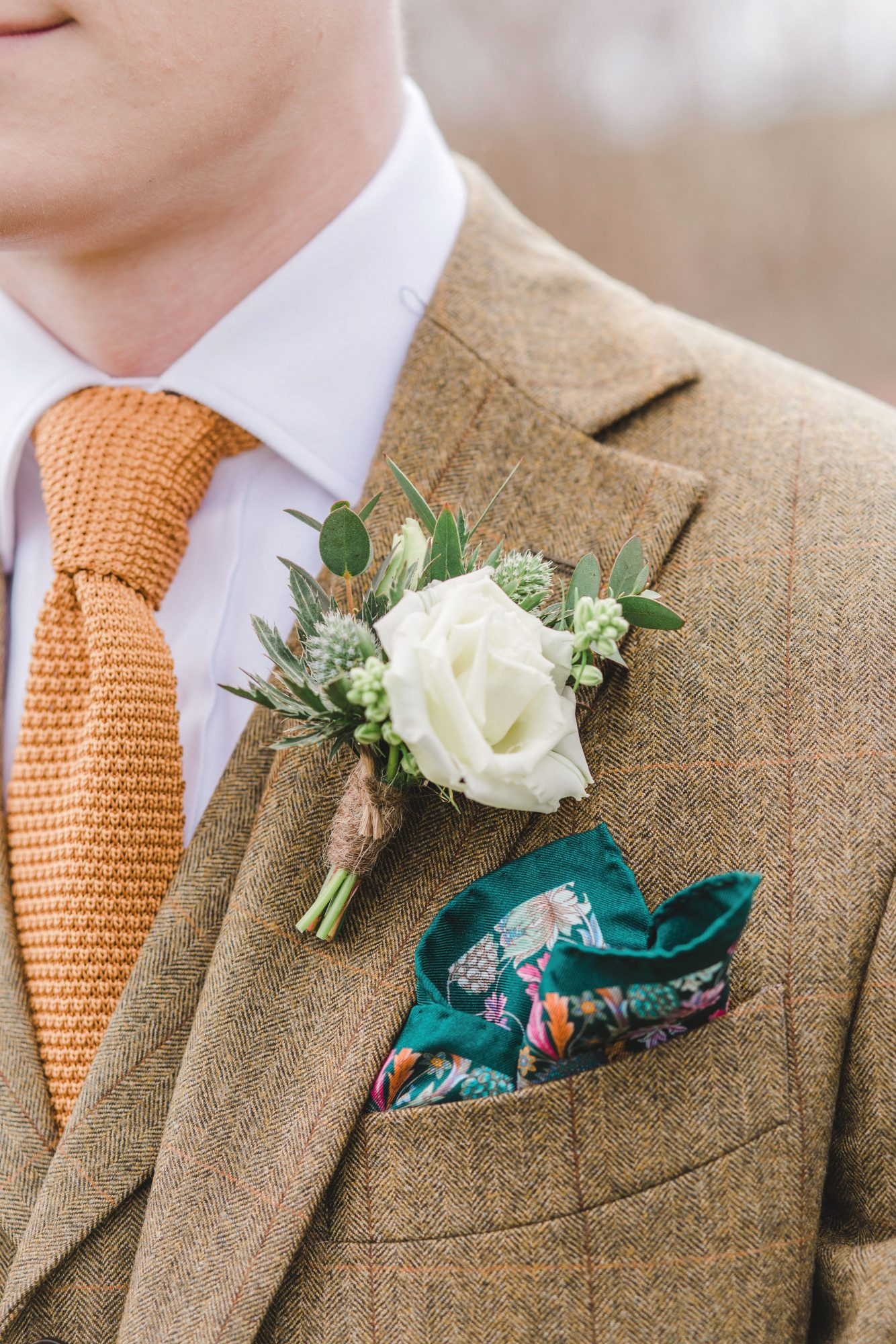 white rose green herb boutonniere