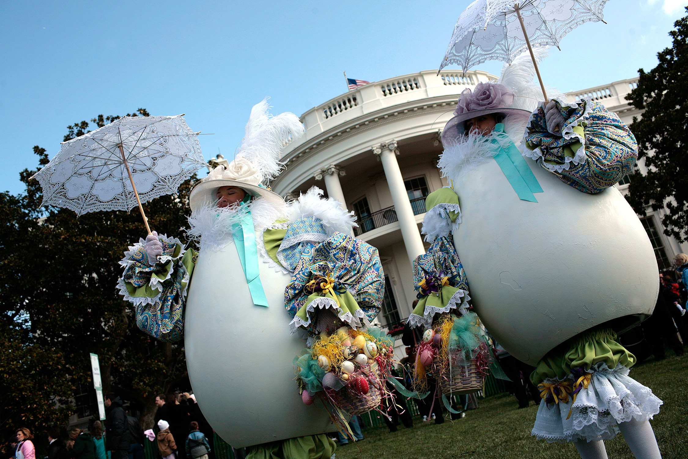 two people wearing egg costumes at white house easter egg roll