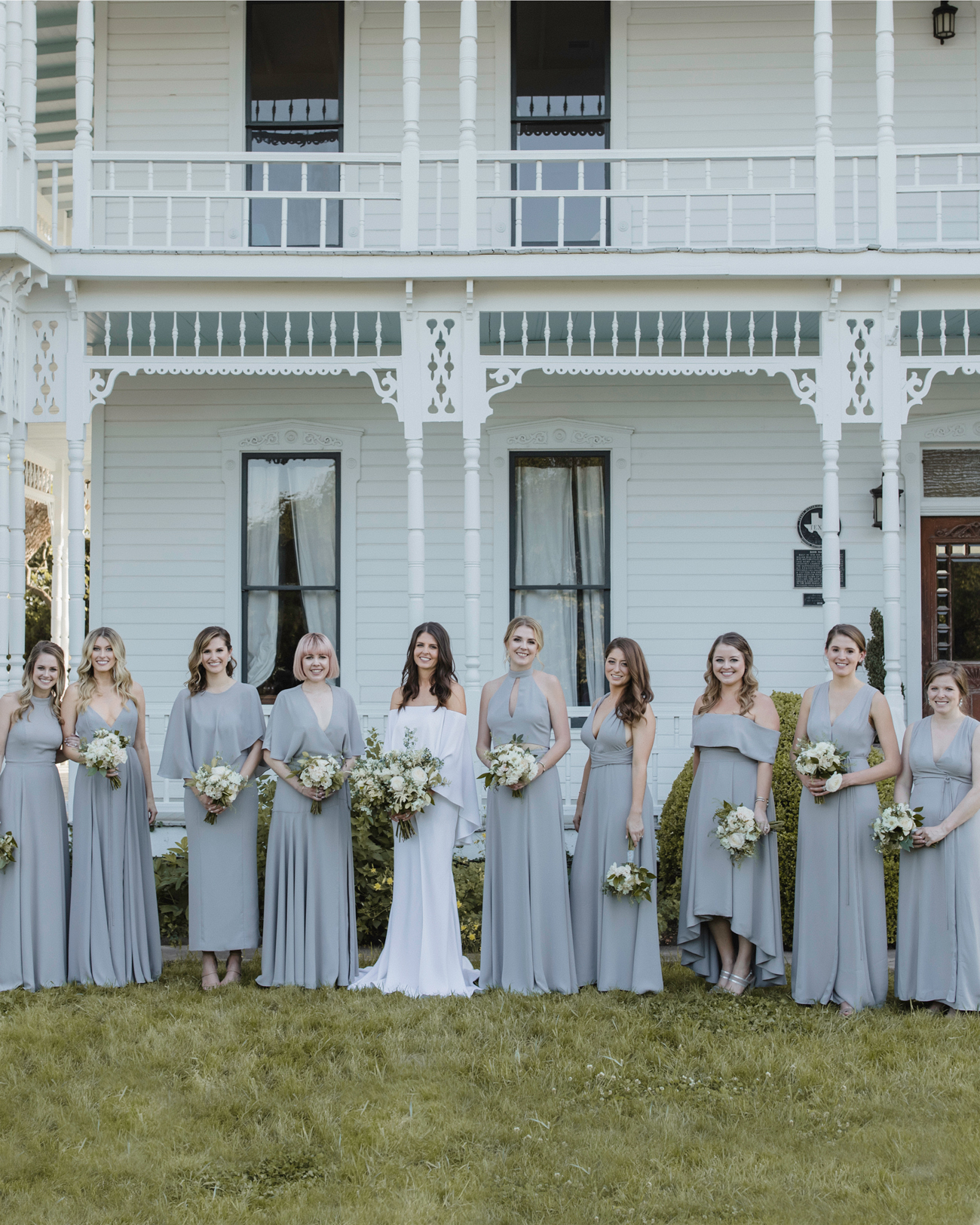 bride with bridesmaids in various style gray dresses