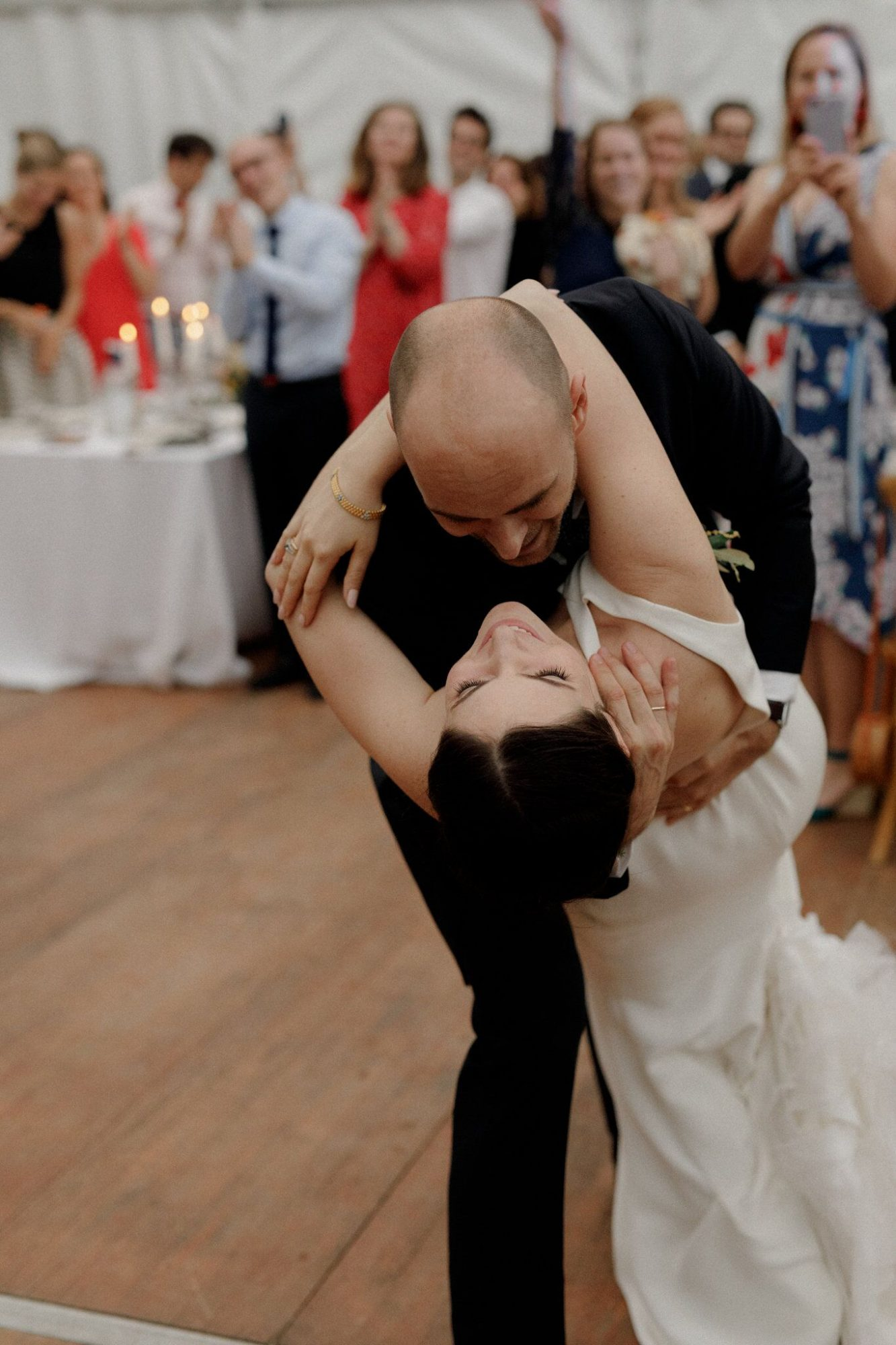 groom dips bride during first dance at reception
