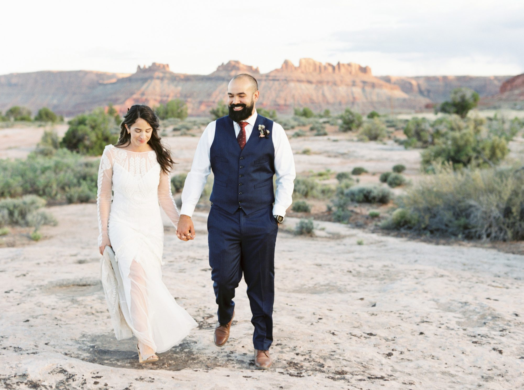 jeanette david wedding desert couple walking