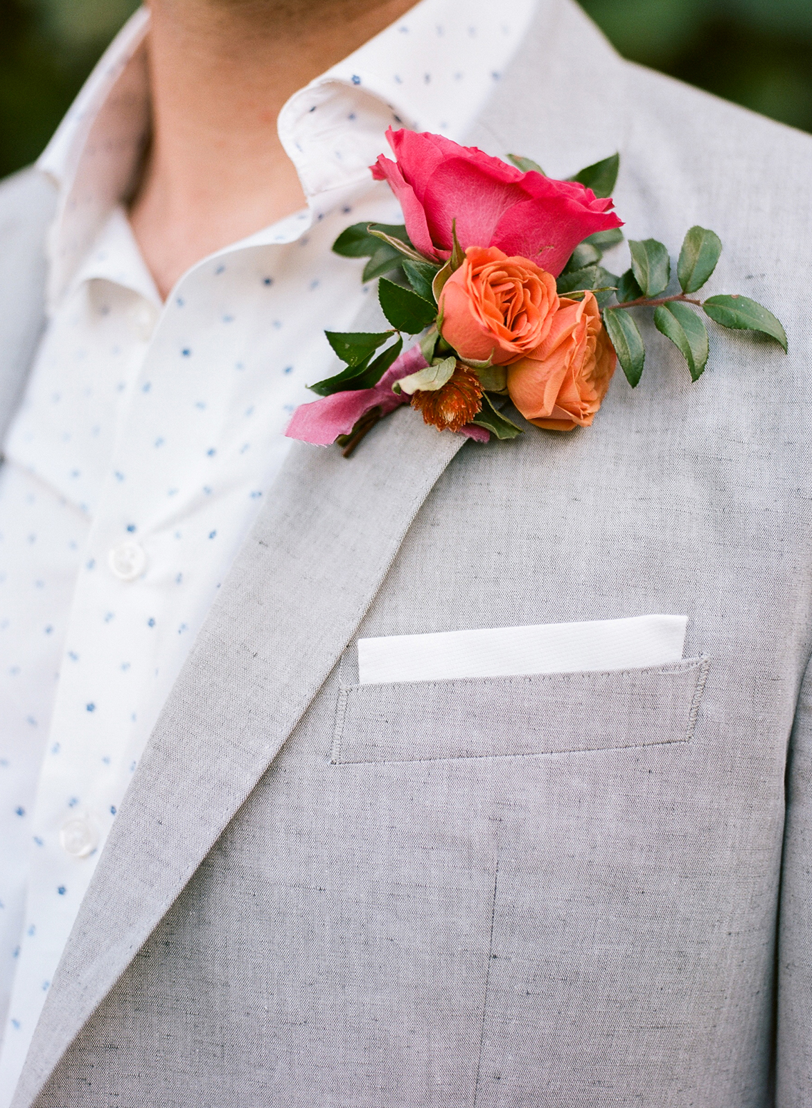 coral and fuchsia floral boutonniere