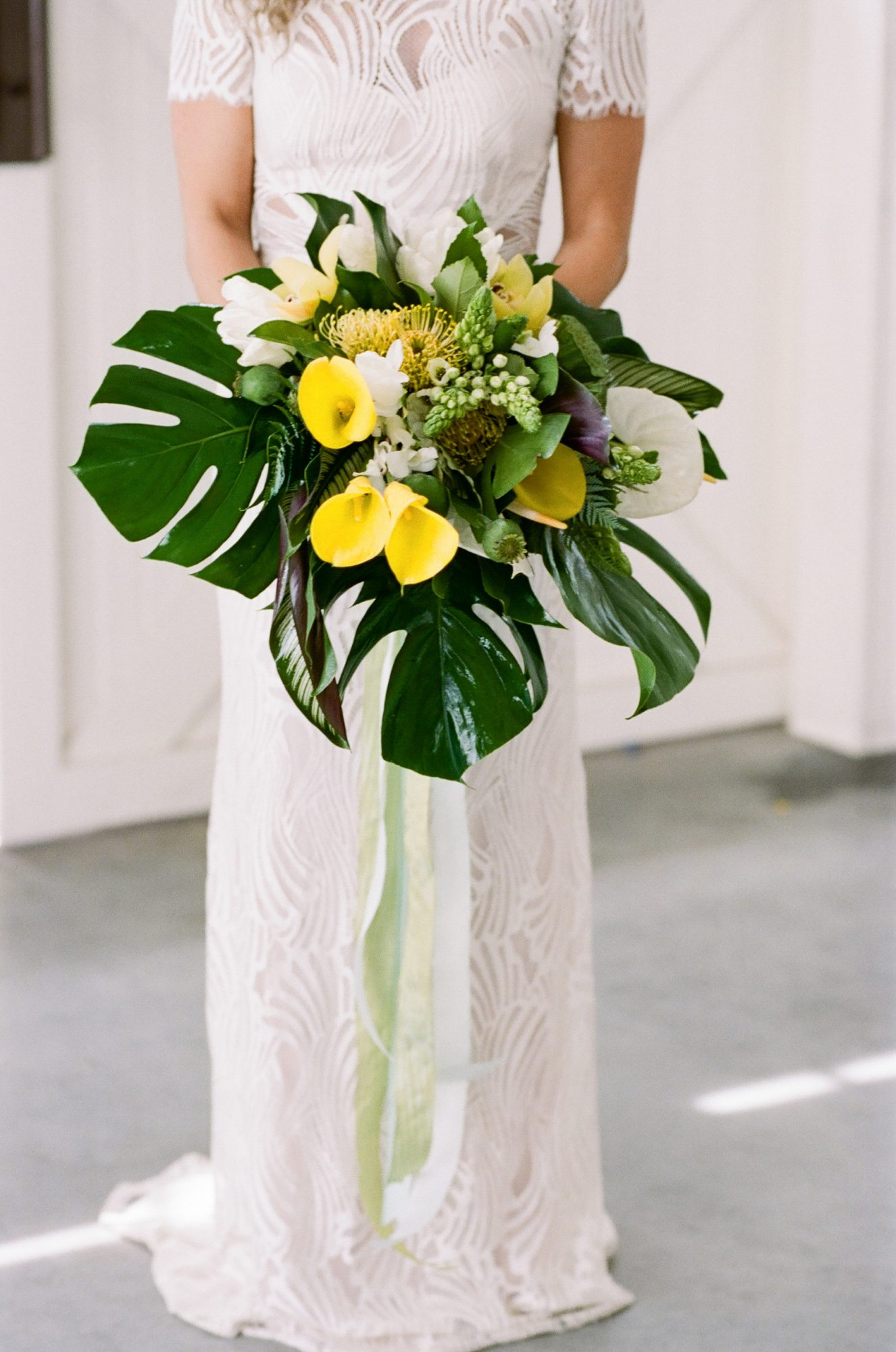 tropical leaf and yellow floral wedding bouquet